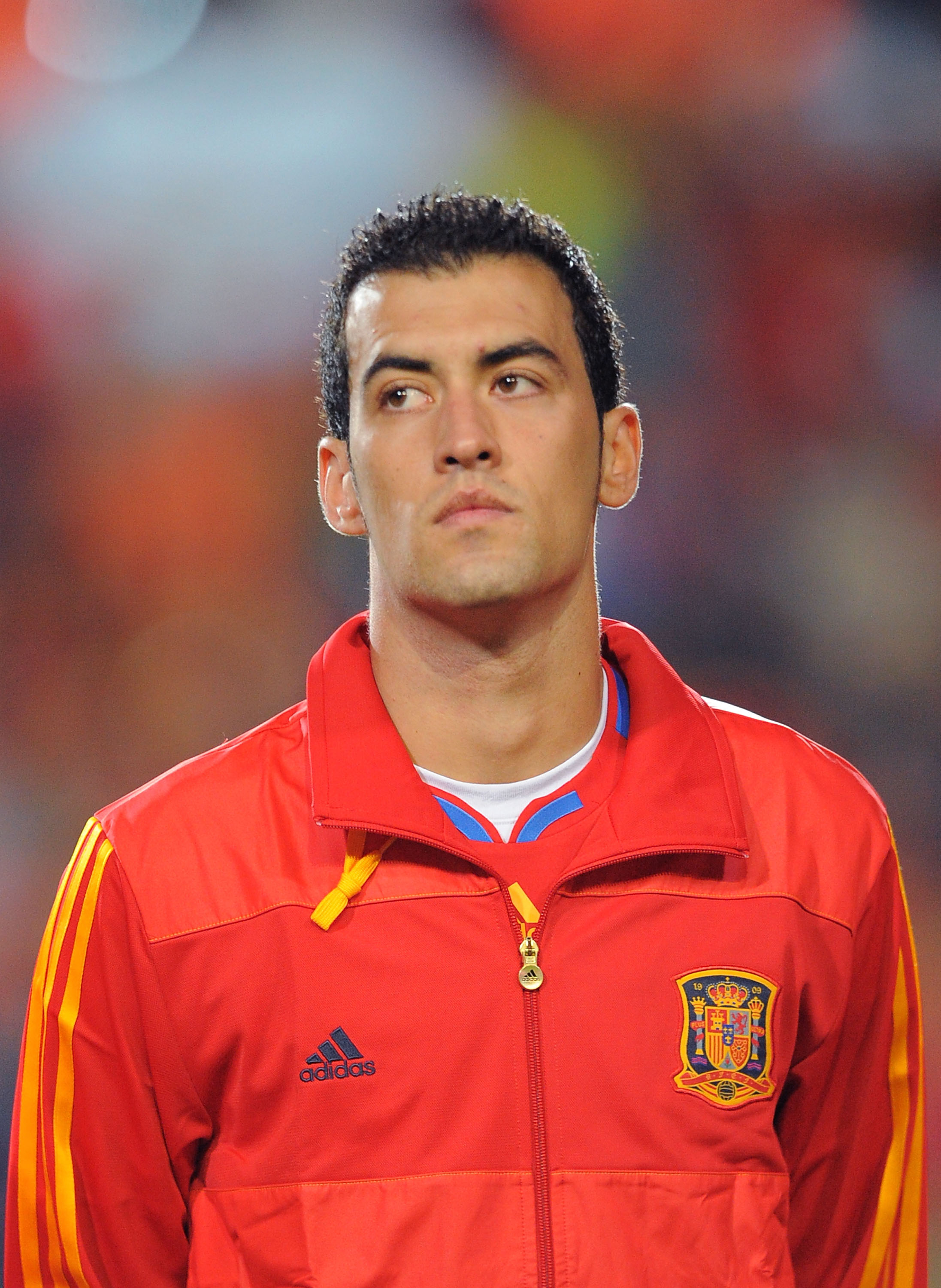 SALAMANCA, SPAIN - OCTOBER 08: Sergio Busquets  of Spain listens to his country's national anthem before the the EURO 2012 Qualifying Group I match between Spain and Lithuania at the Helmantico stadium on October 8, 2010 in Salamanca, Spain.  (Photo by De