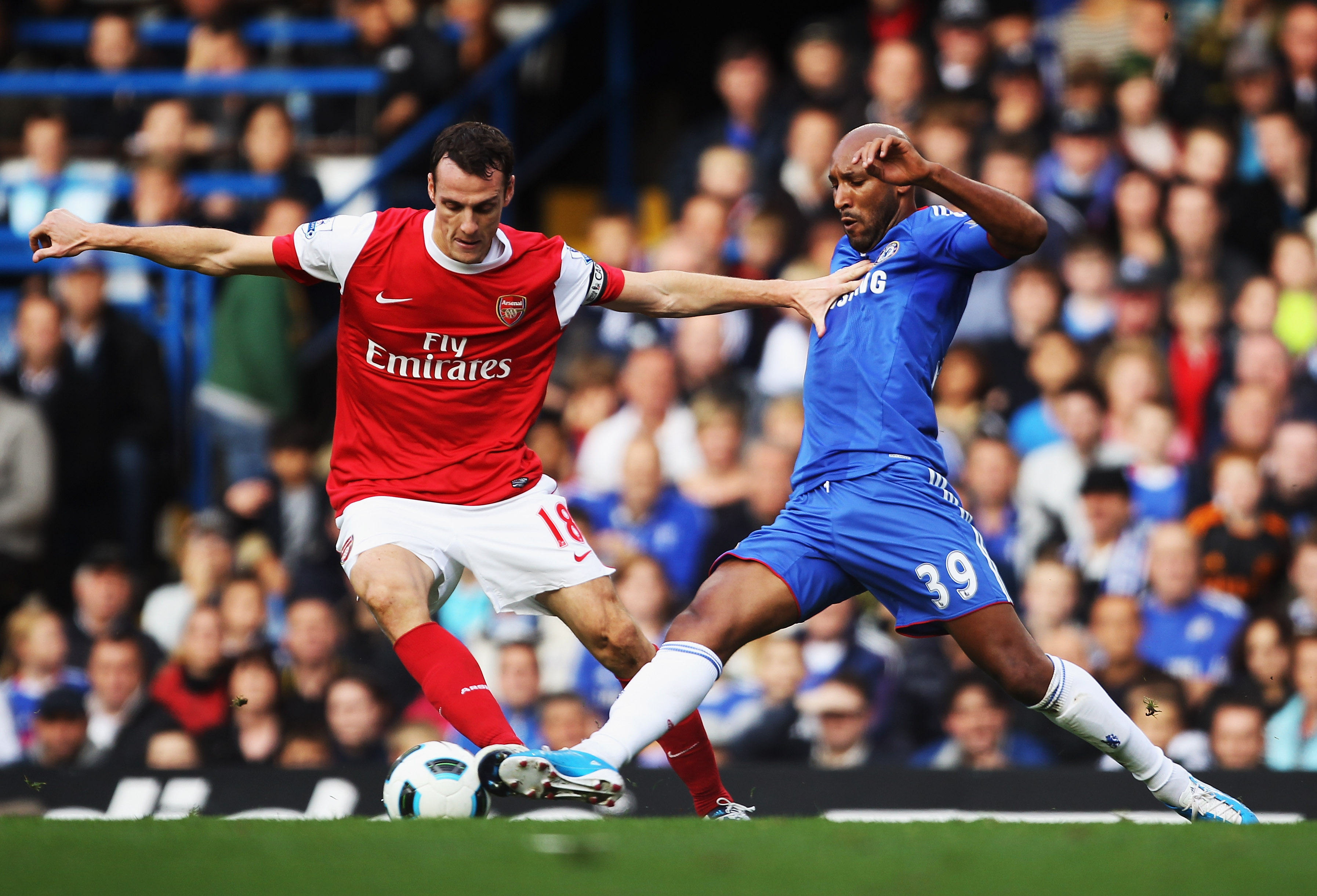 LONDON, ENGLAND - OCTOBER 03:  Nicolas Anelka of Chelsea tackles Sebastien Squillaci of Arsenal during the Barclays Premier League match between Chelsea and Arsenal at Stamford Bridge on October 3, 2010 in London, England.  (Photo by Bryn Lennon/Getty Ima