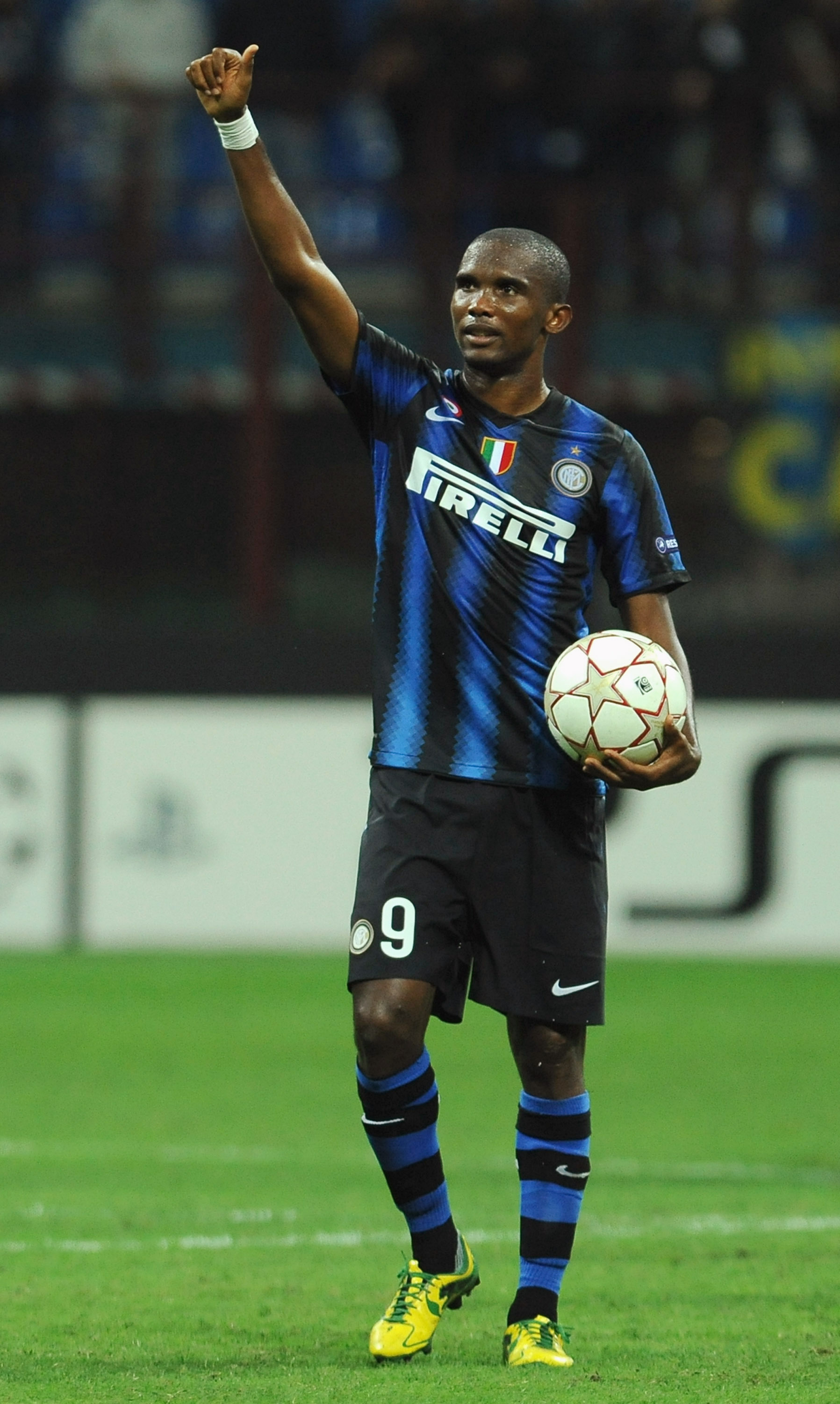 MILAN, ITALY - SEPTEMBER 29:  Samuel Eto'o of FC Internazionale Milano with the ball of the match celebrates victoryafter the UEFA Champions League group A match between FC Internazionale Milano and SV Werder Bremen at Stadio Giuseppe Meazza on September