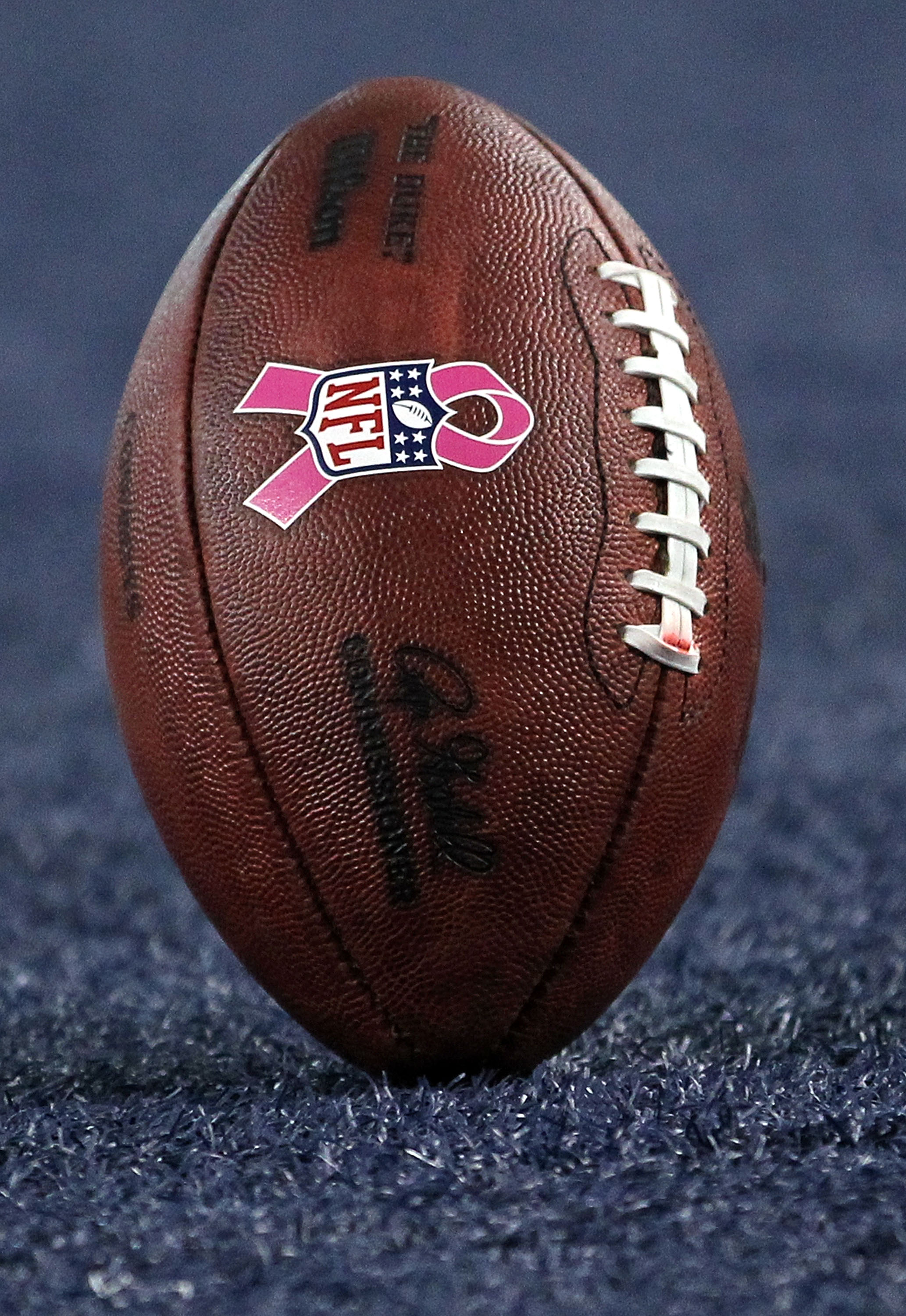 ARLINGTON, TX - OCTOBER 10:  An NFL logo with a pink ribbon for Breast Cancer Awareness month on a football between the Tennessee Titans and the Dallas Cowboys at Cowboys Stadium on October 10, 2010 in Arlington, Texas.  (Photo by Ronald Martinez/Getty Im
