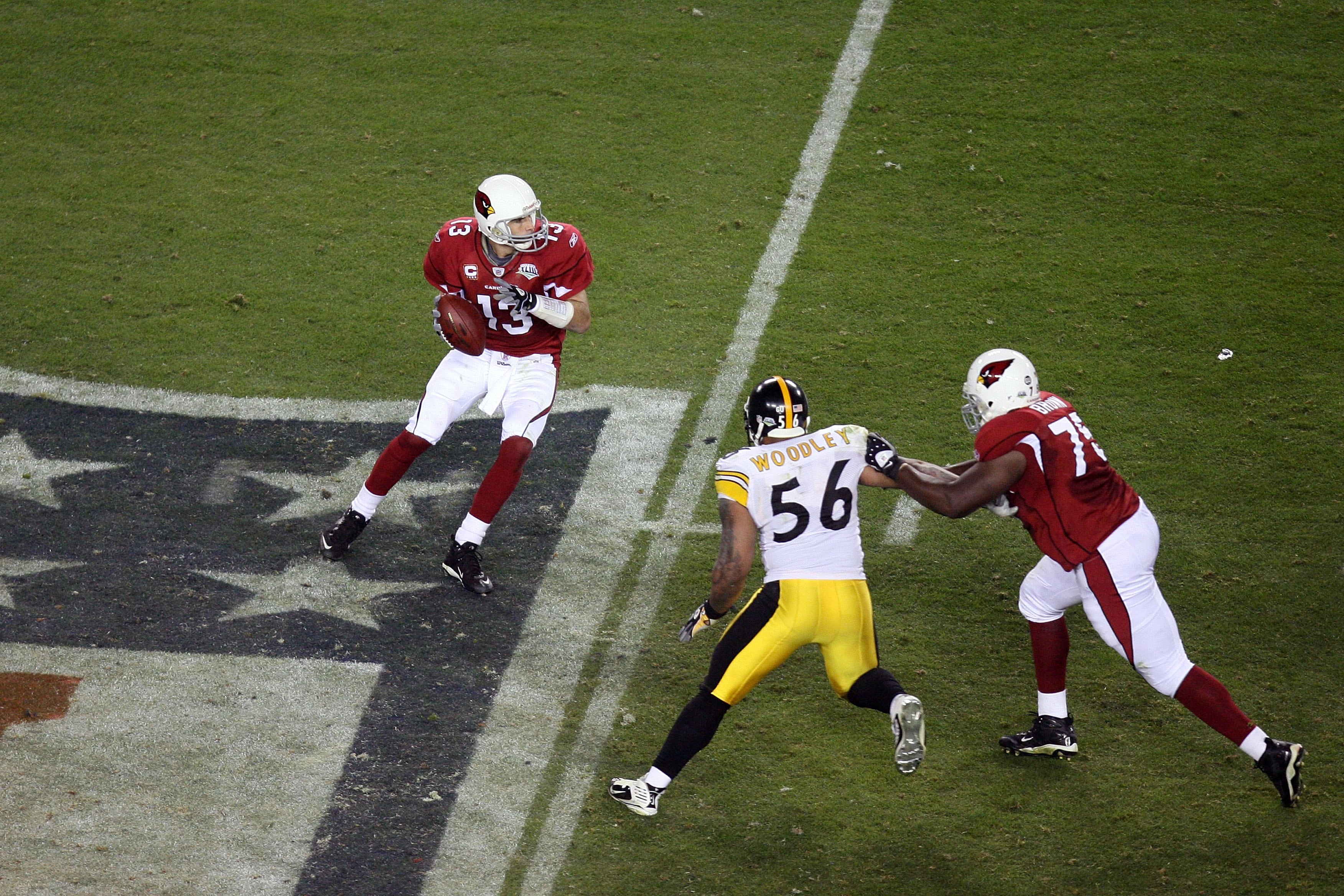 TAMPA, FL - FEBRUARY 01:  Kurt Warner #13 of the Arizona Cardinals looks to pass as Levi Brown #75 attempts to block LaMarr Woodley #56 of the Pittsburgh Steelers during Super Bowl XLIII on February 1, 2009 at Raymond James Stadium in Tampa, Florida. Stee