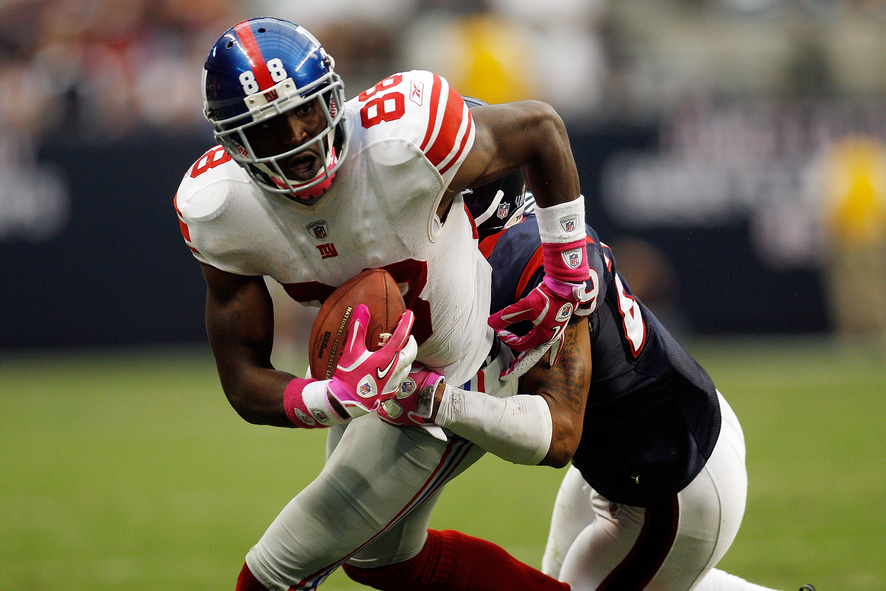 HOUSTON - OCTOBER 10:  Hakeem Nicks #88 of the New York Giants is tackled by Glover Quin #29 of the Houston Texans at Reliant Stadium on October 10, 2010 in Houston, Texas.  (Photo by Chris Graythen/Getty Images)