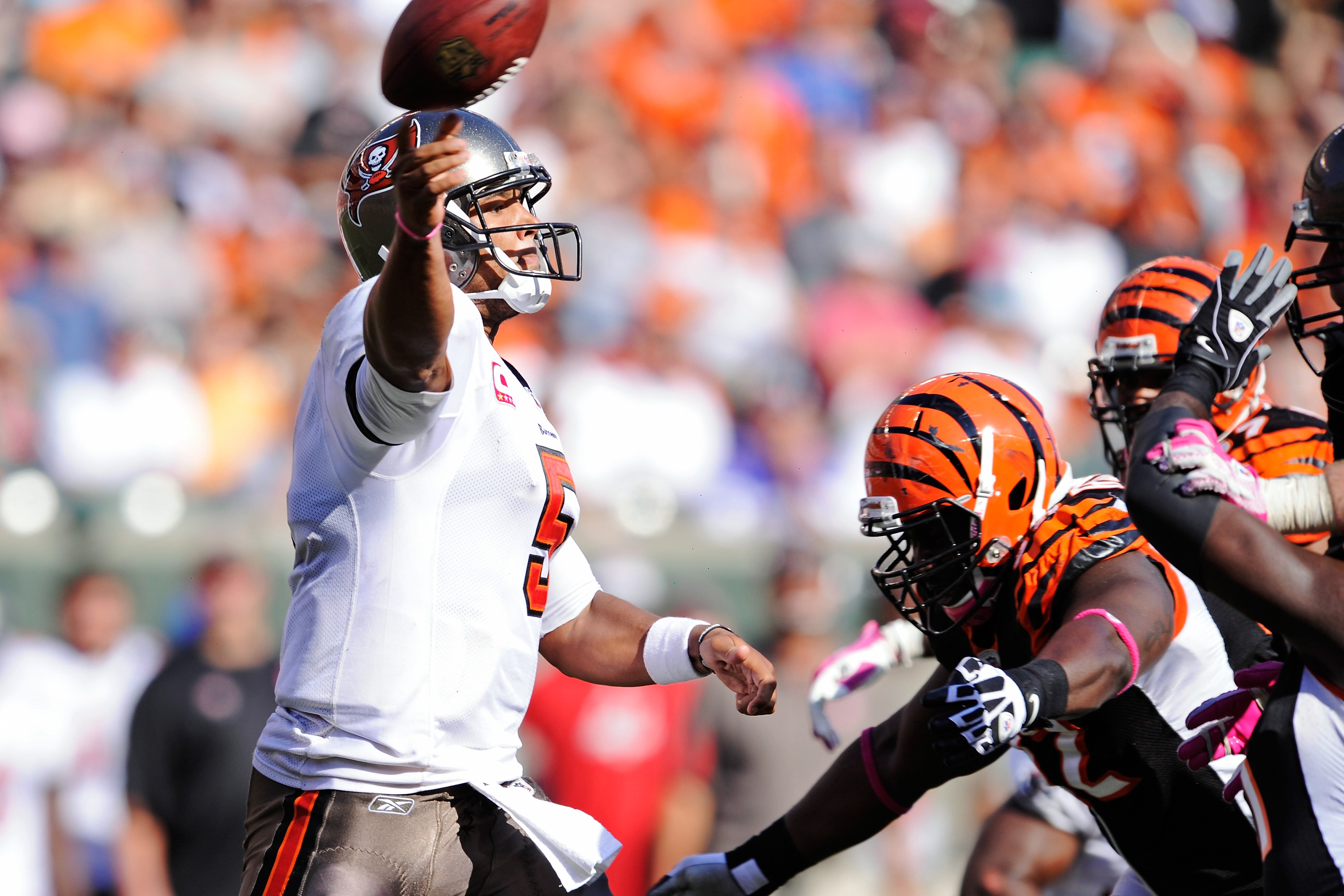 CINCINNATI, OH - OCTOBER 10:  Quarterback Josh Freeman #5 of the Tampa Bay Buccaneers gets off a pass as he is pressured by the Cincinnati Bengals defense at Paul Brown Stadium on October 10, 2010 in Cincinnati, Ohio.  (Photo by Jamie Sabau/Getty Images)