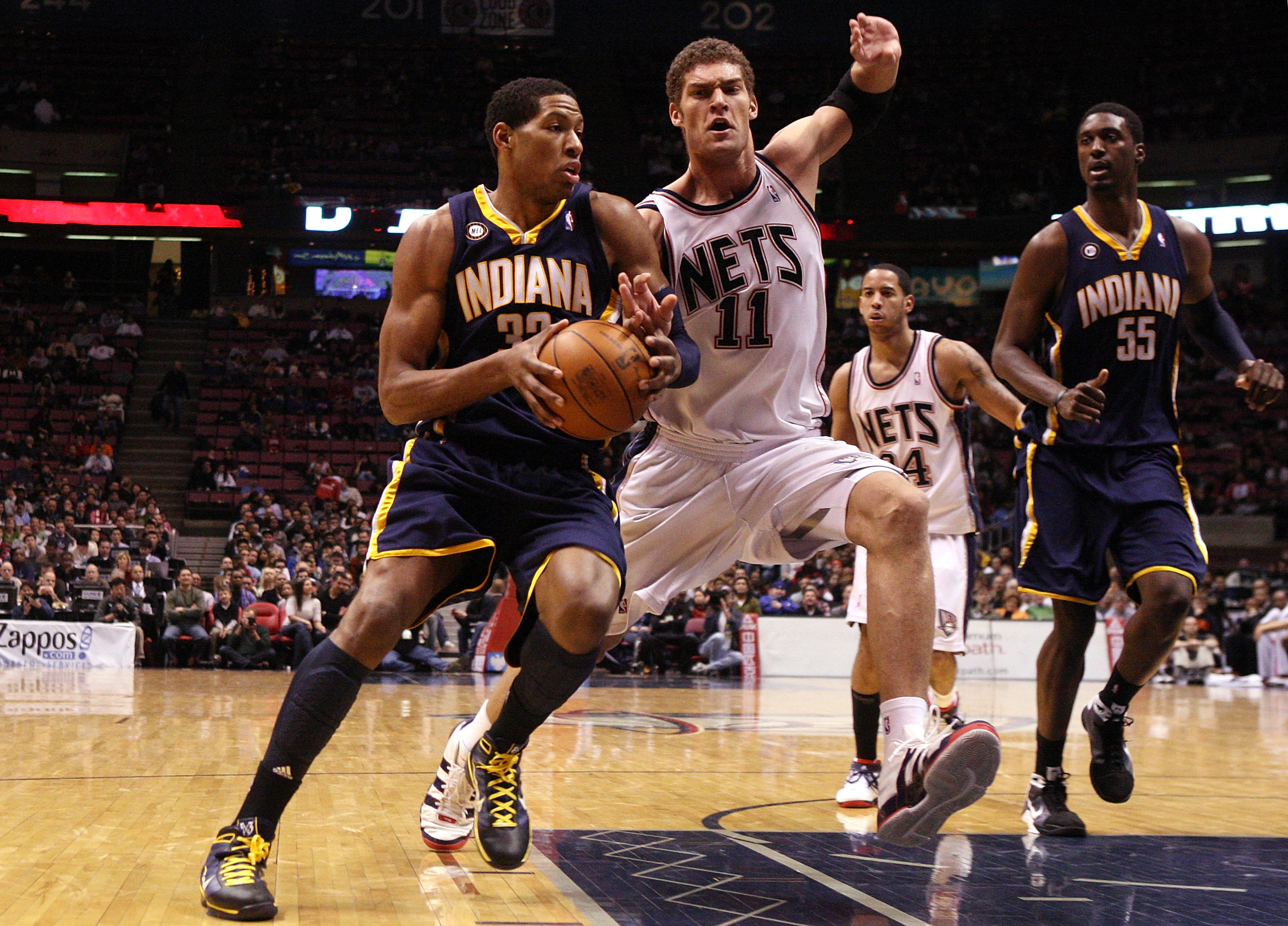 EAST RUTHERFORD, NJ - JANUARY 15:  Danny Granger #33 of the Indiana Pacers drives against Brook Lopez #11 of the New Jersey Nets at the Izod Center on January 15, 2010 in East Rutherford, New Jersey. NOTE TO USER: User expressly acknowledges and agrees th