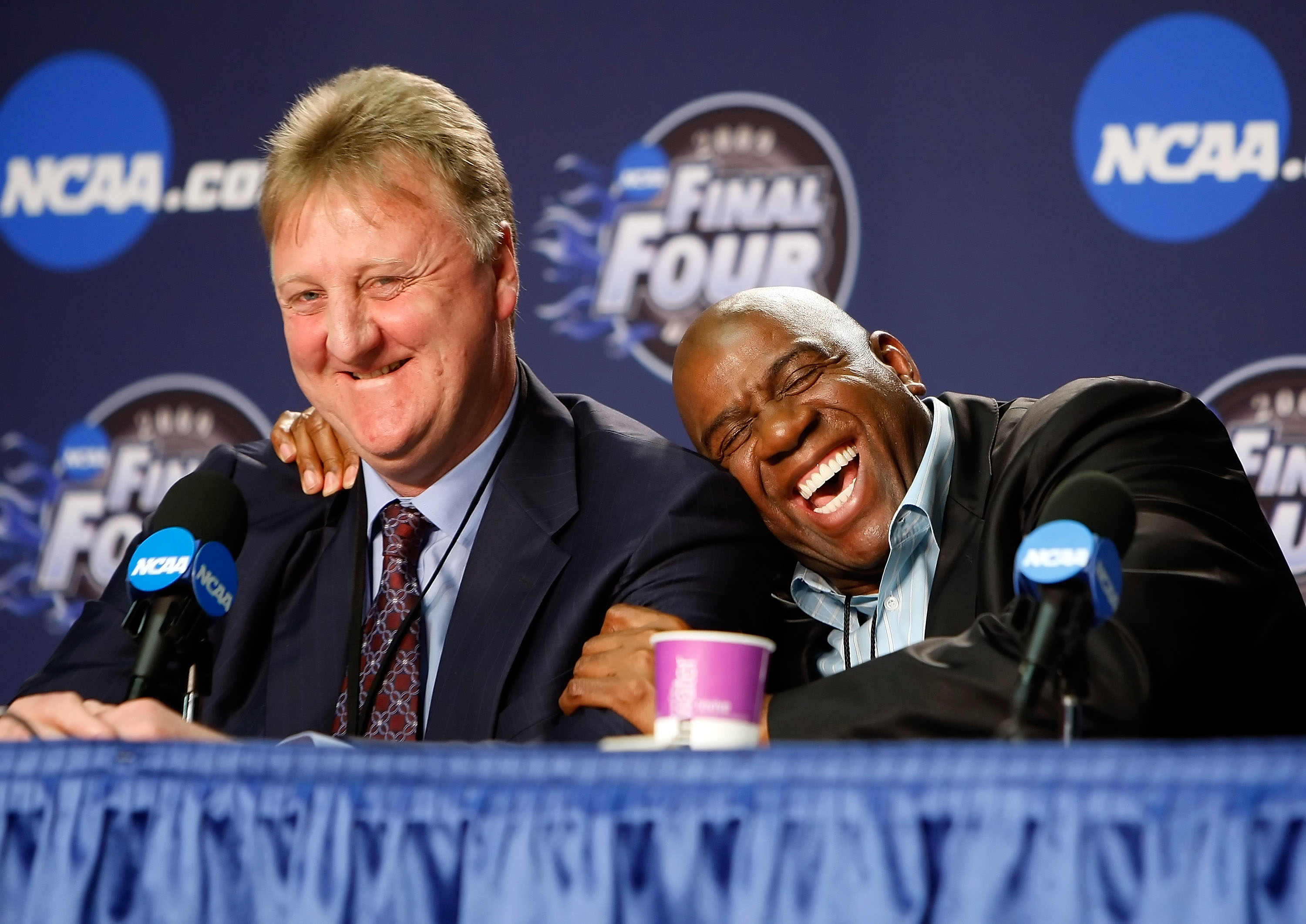 DETROIT - APRIL 06:  (L-R) Larry Bird and Earvin 'Magic' Johnson embrace during a news conference to relive their 1979 NCAA Championship Game between Indiana State and Michigan State before the 2009 NCAA Division I Men's Basketball National Championship g