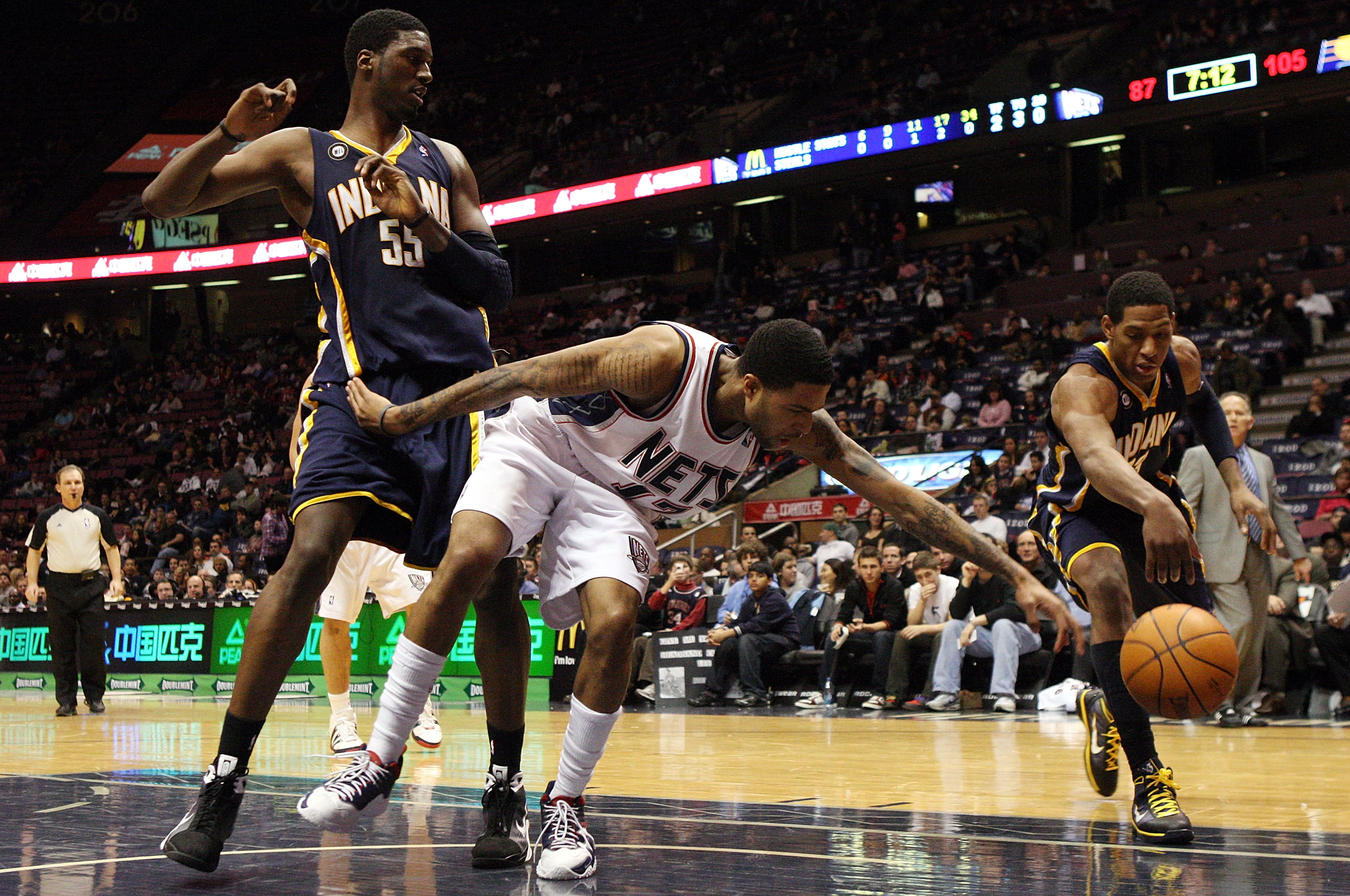 EAST RUTHERFORD, NJ - JANUARY 15:  Chris Douglas-Roberts #17 of the New Jersey Nets loses the ball against Danny Granger #33 and Roy Hibbert #55 of the Indiana Pacers at the Izod Center on January 15, 2010 in East Rutherford, New Jersey. NOTE TO USER: Use