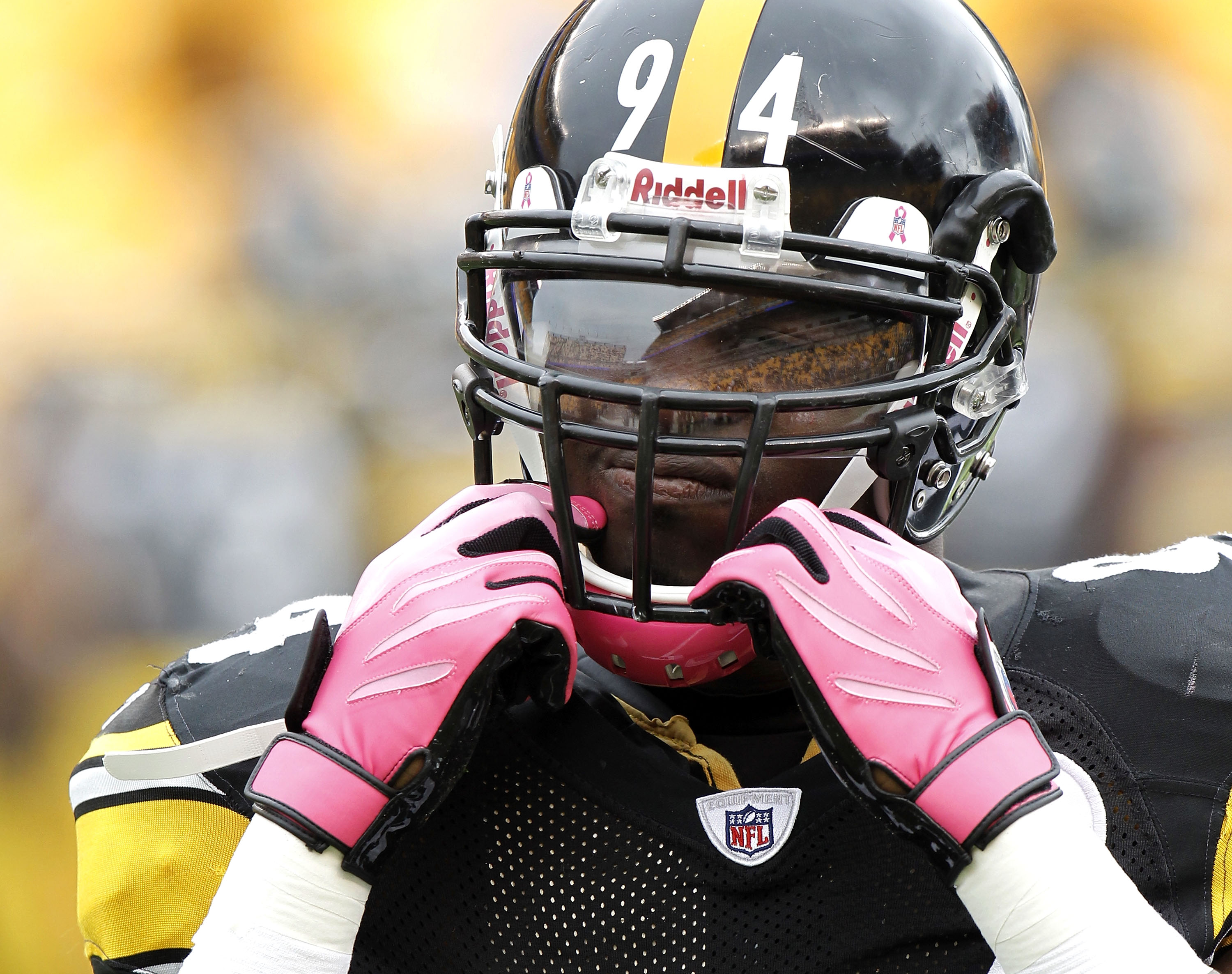 PITTSBURGH - OCTOBER 03:  Lawrence Timmons #94 of the Pittsburgh Steelers wears a pink chin strap and gloves for breast cancer awareness prior to playing the Baltimore Ravens on October 3, 2010 at Heinz Field in Pittsburgh, Pennsylvania.  (Photo by Gregor