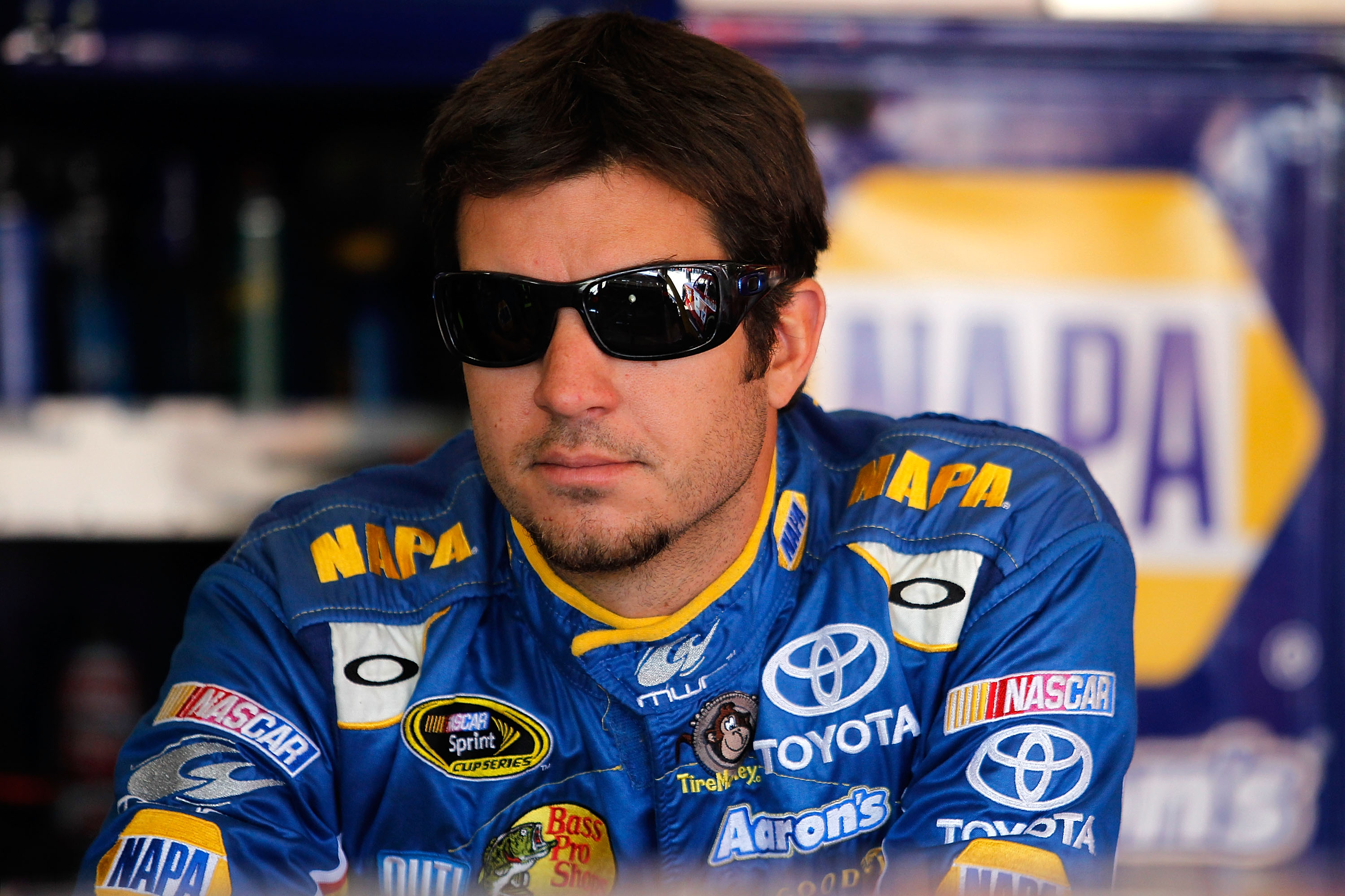 FONTANA, CA - OCTOBER 09:  Martin Truex Jr., driver of the #56 NAPA Toyota, stands in the garage during practice for the NASCAR Sprint Cup Series Pepsi Max 400 on October 9, 2010 in Fontana, California.  (Photo by Todd Warshaw/Getty Images for NASCAR)