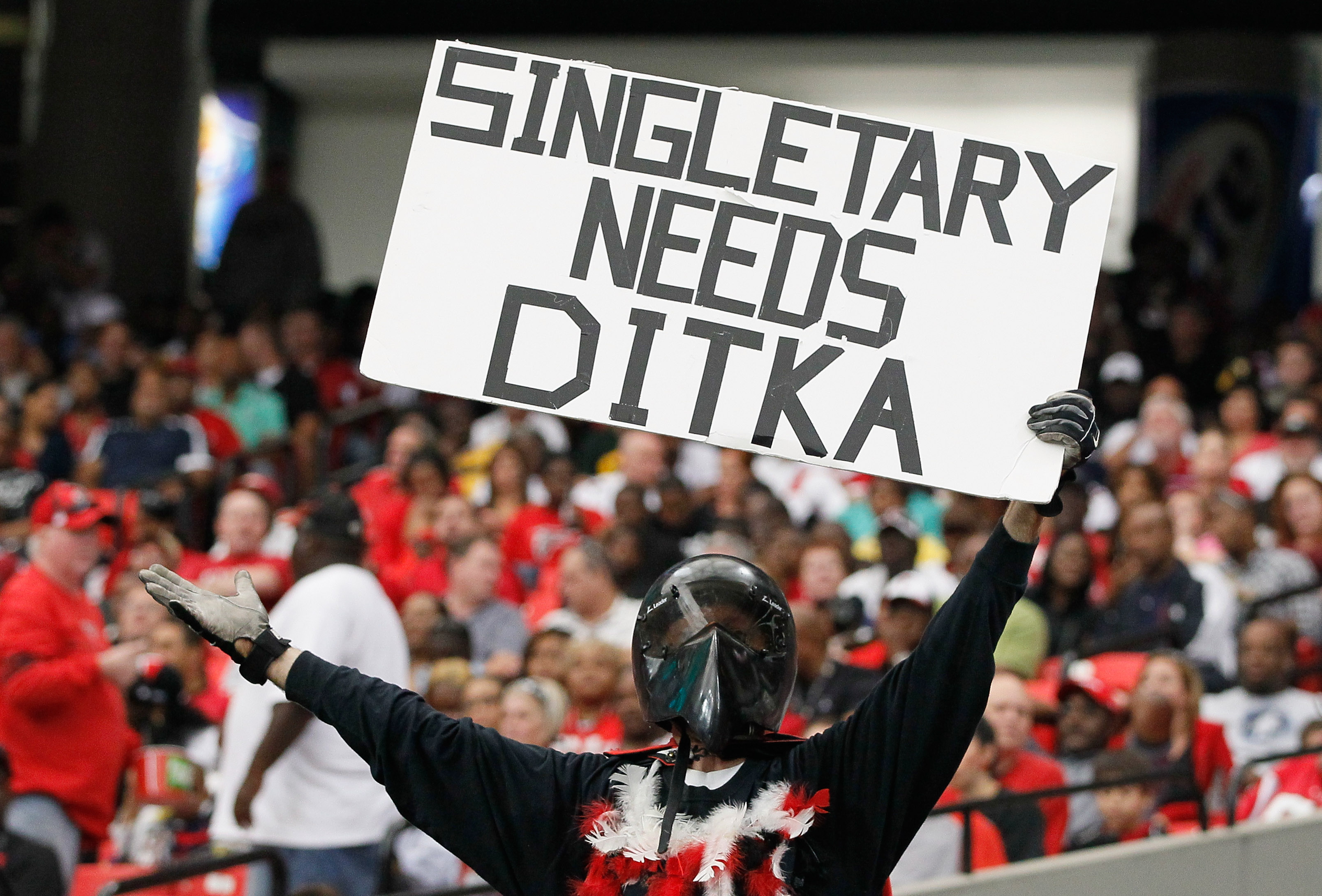 ATLANTA - OCTOBER 03:  A fan of the Atlanta Falcons holds up a sign about Hall of Famer Mike Ditka and head coach Mike Singletary of the San Francisco 49ers at Georgia Dome on October 3, 2010 in Atlanta, Georgia.  (Photo by Kevin C. Cox/Getty Images)