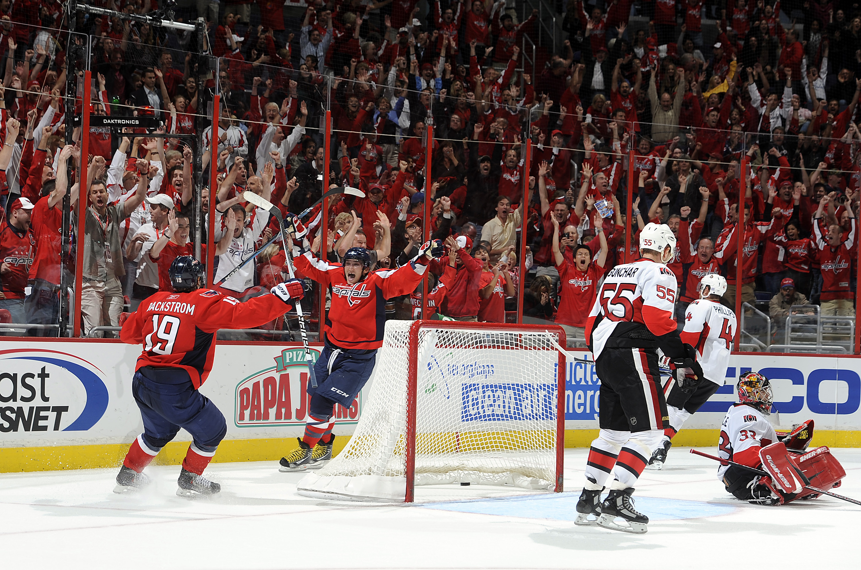 WASHINGTON - OCTOBER 11:  Alex Ovechkin #8 of the Washington Capitals celebrates with Nicklas Backstrom #19 after scoring the winning goal in overtime against Pascal Leclaire #33 of the Ottawa Senators at the Verizon Center on October 11, 2010 in Washingt