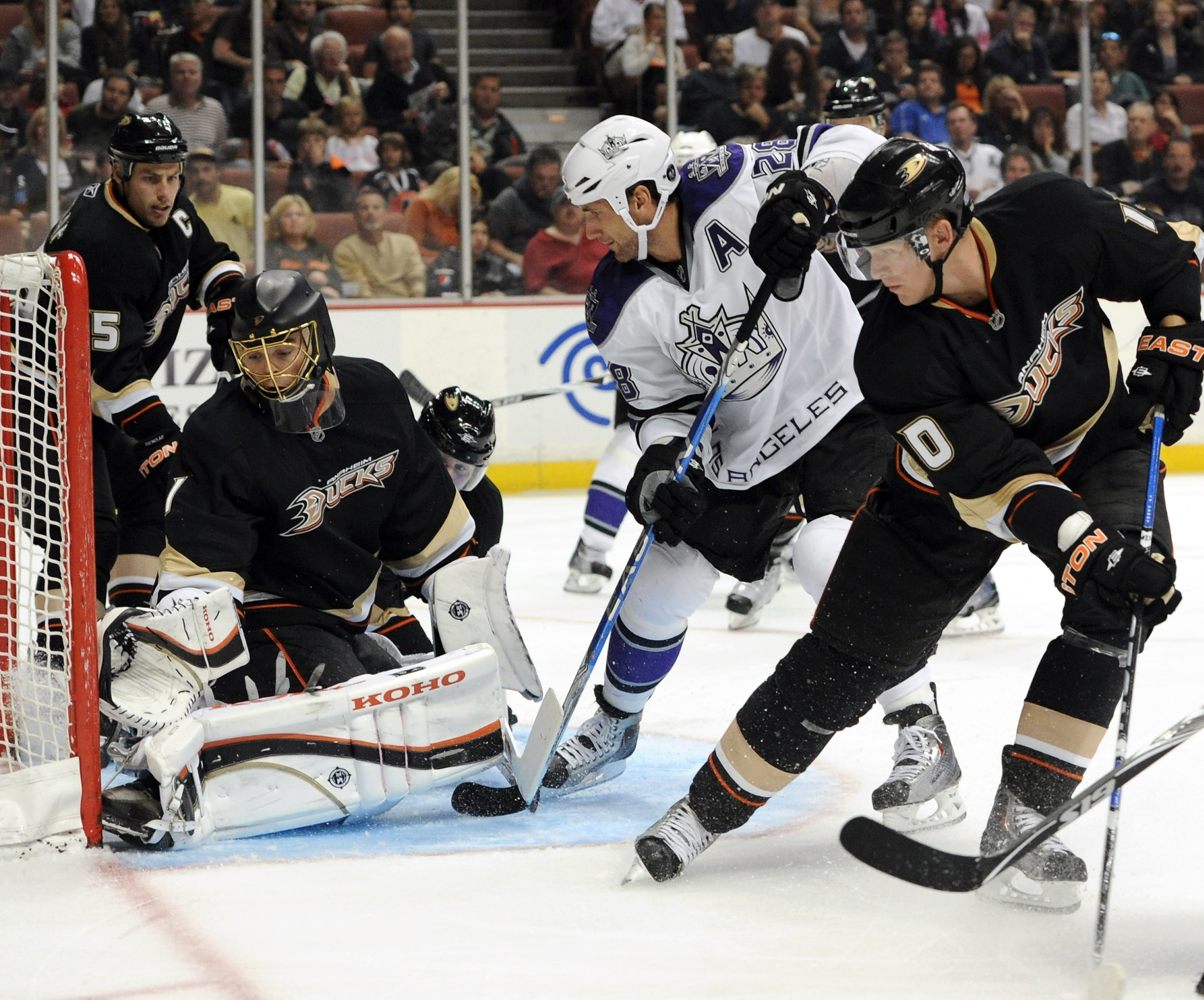 ANAHEIM, CA - OCTOBER 03:  Jonas Hiller #1 of the Anaheim Ducks makes a save on Jarret Stoll #28 of the Los Angeles Kings as Corey Perry #10 and Ryan Getzlaf #15 look for a rebound at Honda Center on October 3, 2010 in Anaheim, California.  (Photo by Harr