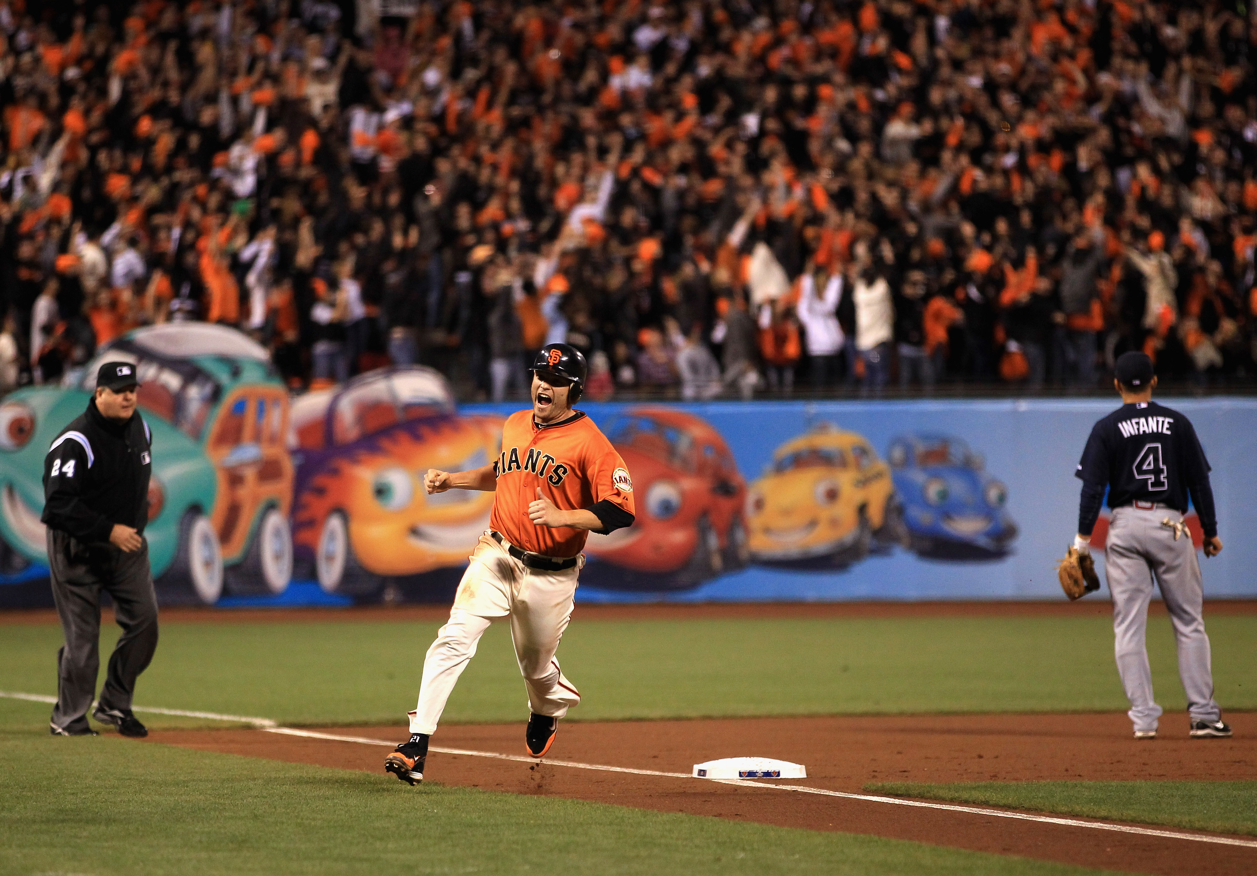 SAN FRANCISCO - OCTOBER 08:  Freddy Sanchez #21 of the San Francisco Giants reacts as he rounds third base on a home run by Pat Burrell #9 in the first inning against the Atlanta Braves in game 2 of the NLDS at AT&T Park on October 8, 2010 in San Francisc