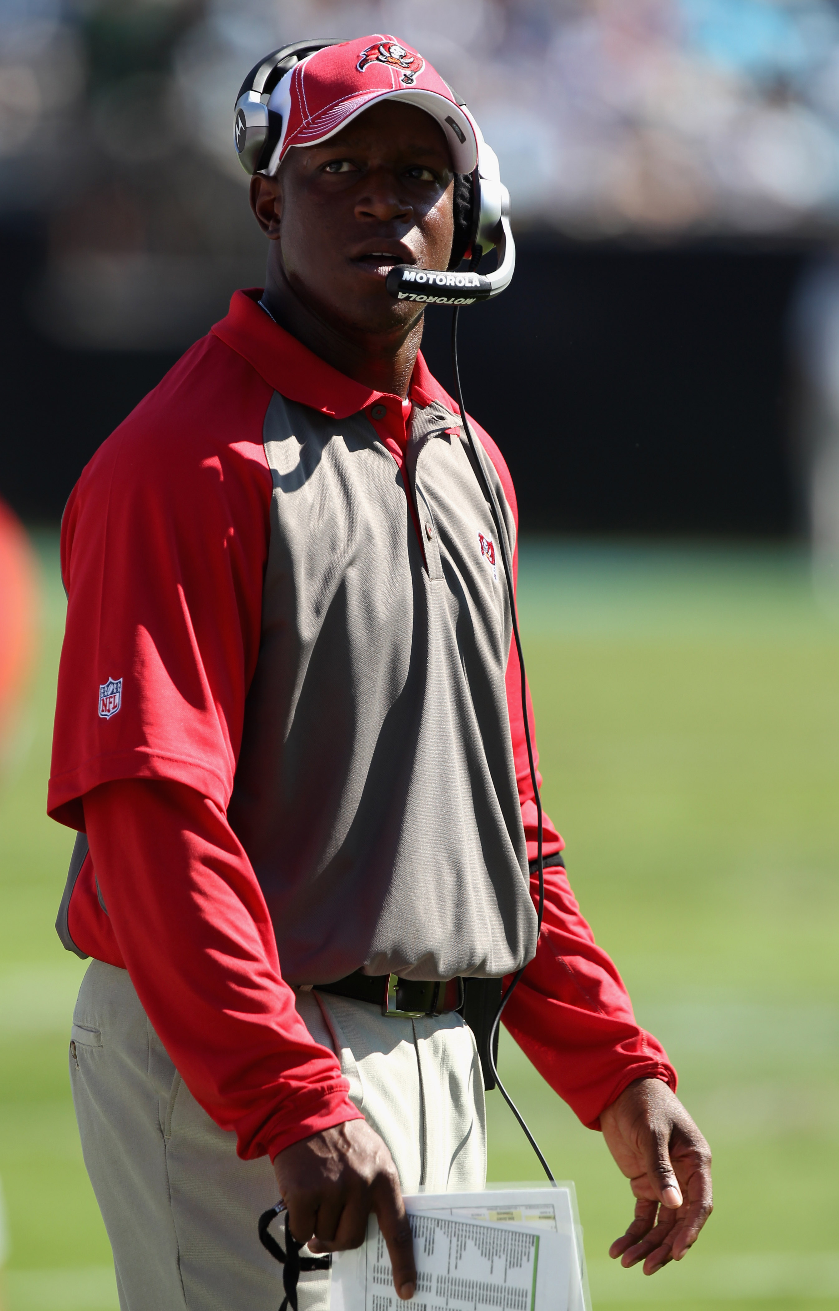 CHARLOTTE, NC - SEPTEMBER 19:  Head coach Raheem Morris of the Tampa Bay Buccaneers looks on against the Carolina Panthers during their game at Bank of America Stadium on September 19, 2010 in Charlotte, North Carolina.  (Photo by Streeter Lecka/Getty Ima