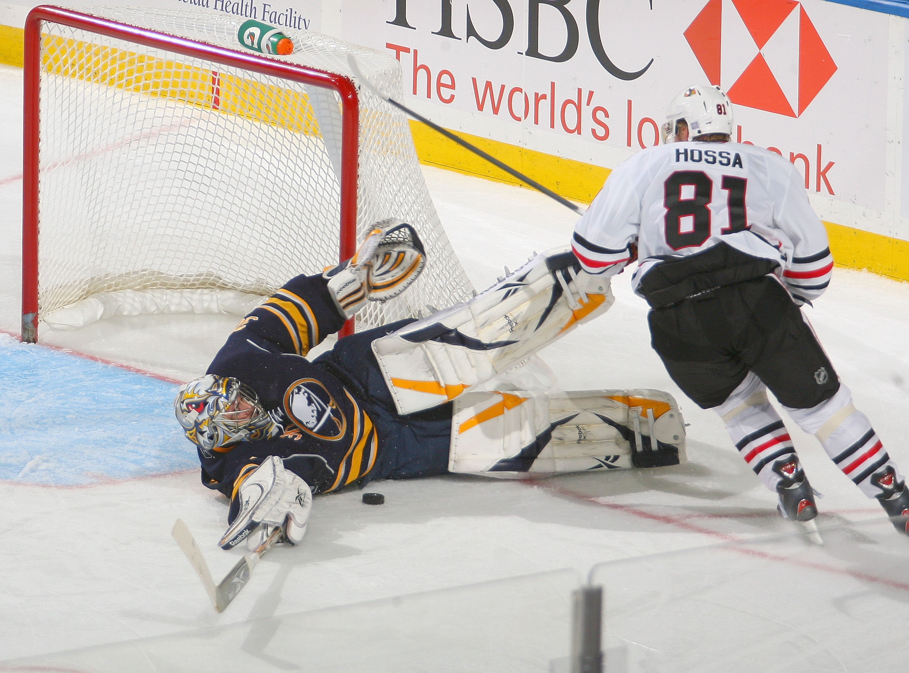 BUFFALO, NY - OCTOBER 11: Ryan Miller #30 of the Buffalo Sabres makes a sliding save on Marian Hossa #81 of the Chicago Blackhawks at HSBC Arena on October 11, 2010 in Buffalo, New York. Chicago won 4-3.  (Photo by Rick Stewart/Getty Images)