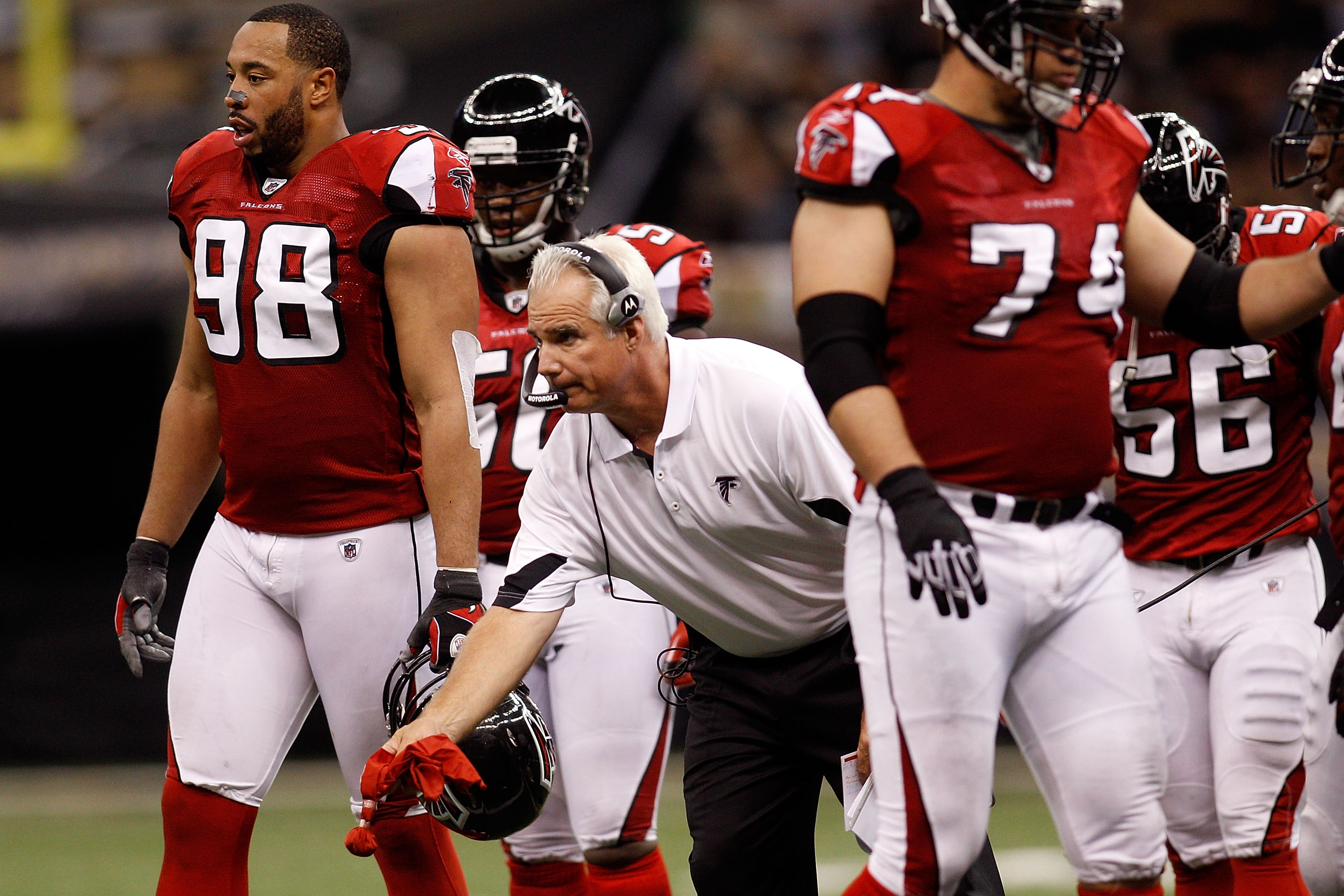 NEW ORLEANS - SEPTEMBER 26:  Head coach Mike Smith of the Atlanta Falcons throws out the red challenge flag during the game against the New Orleans Saints at the Louisiana Superdome on September 26, 2010 in New Orleans, Louisiana. The Falcons defeated the