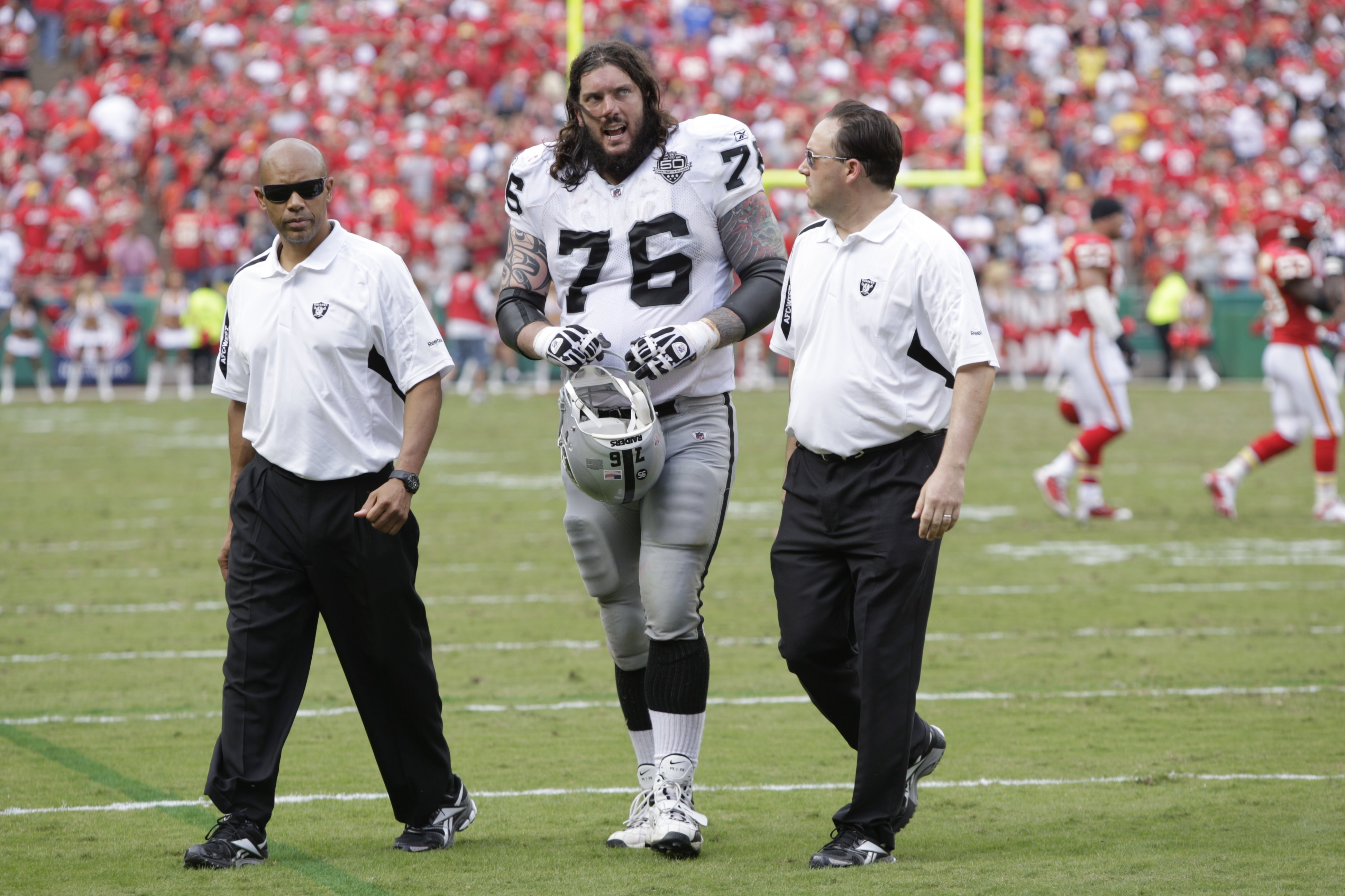 KANSAS CITY, MO - SEPTEMBER 20:  Robert Gallery #76 of the Oakland Raiders walks off the field during the game against the Kansas City Chiefs at Arrowhead Stadium on September 20, 2009 in Kansas City, Missouri. (Photo by Jamie Squire/Getty Images)