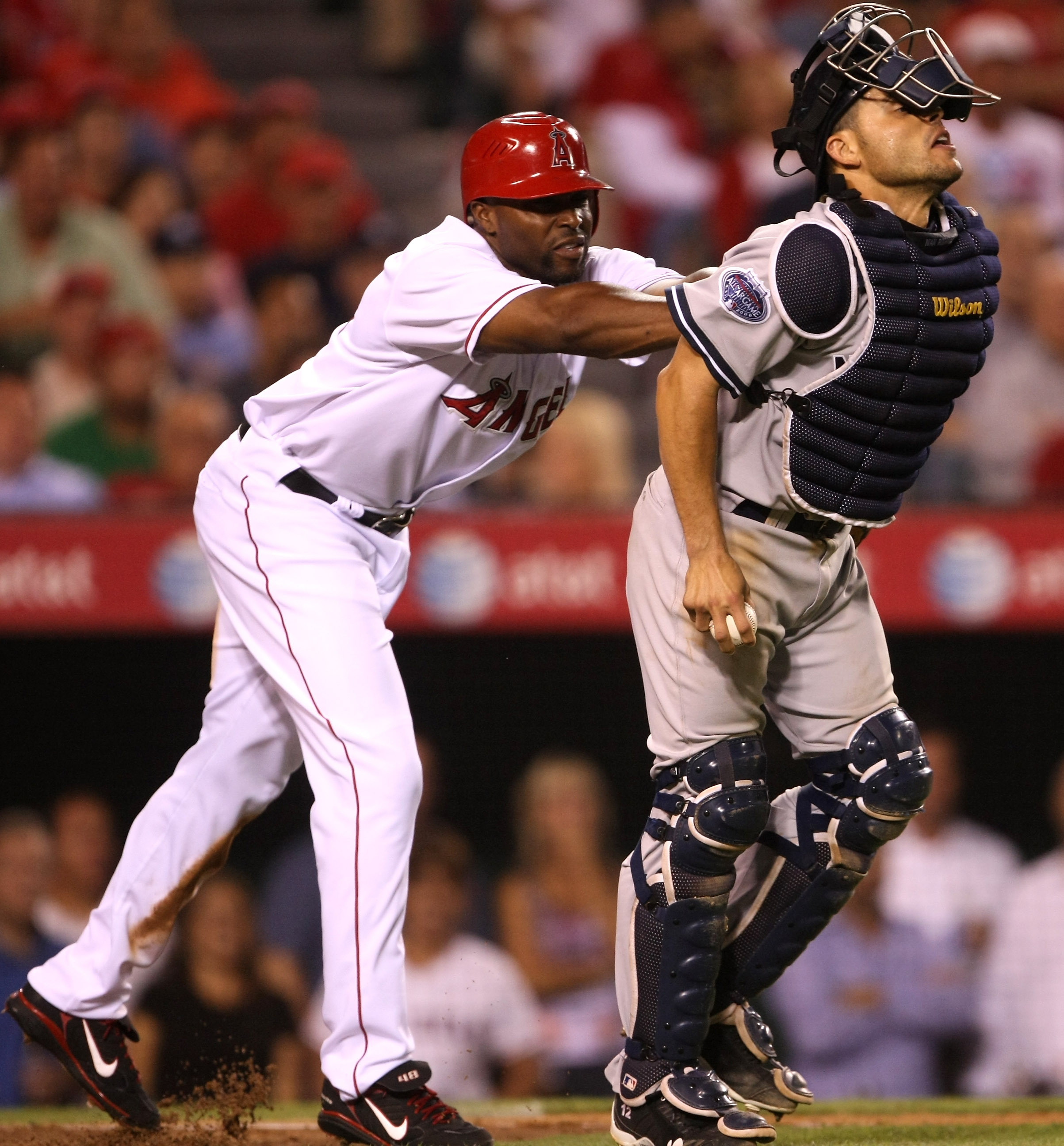 ANAHEIM, CA - SEPTEMBER 08:  Torii Hunter #48 of the Los Angeles Angels of Anaheim pushes catcher Ivan Rodriguez of the New York Yankees after being tagged out on September 8, 2008 at Angel Stadium in Anaheim, California.  The action triggered a dugout cl