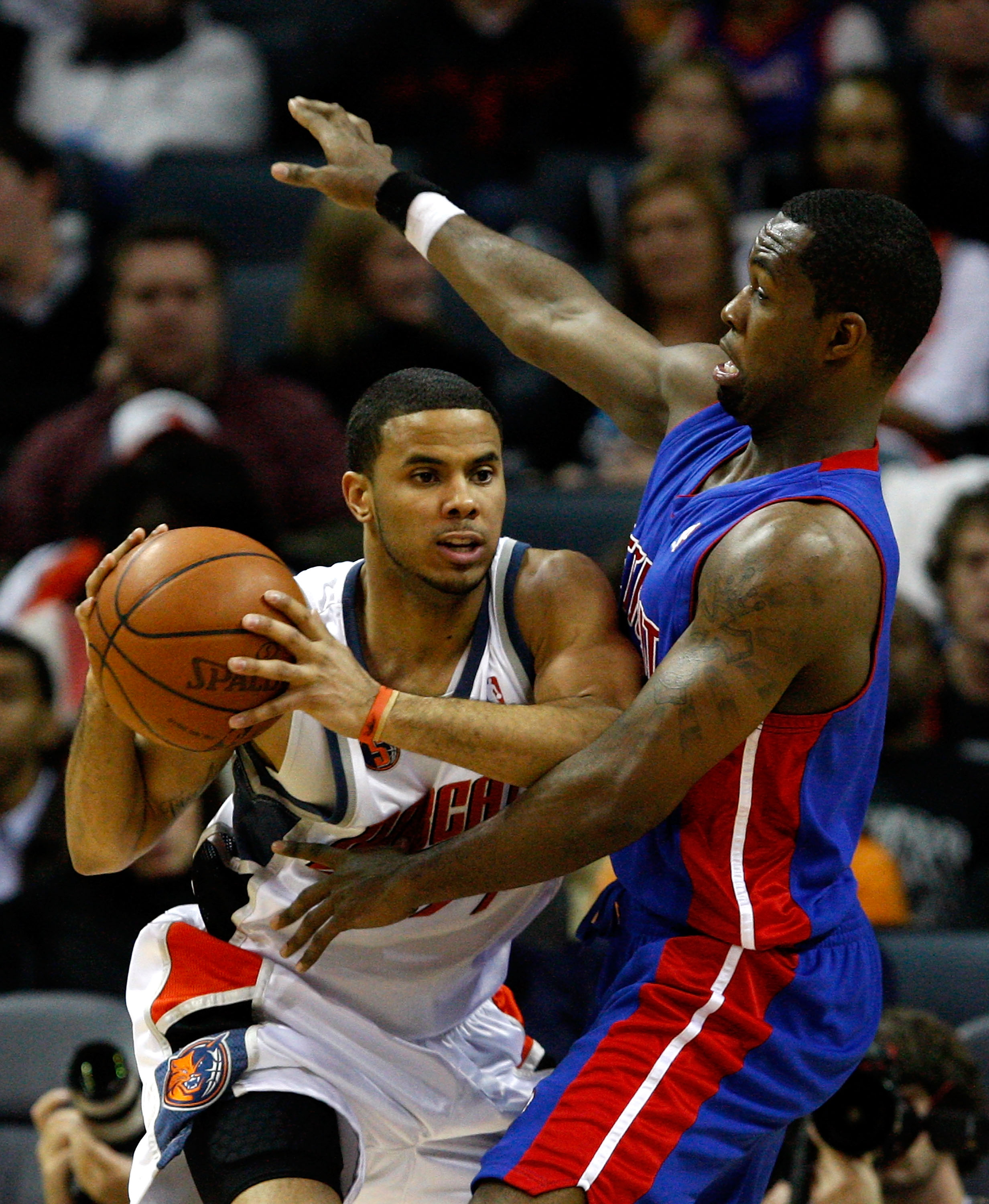 CHARLOTTE, NC - DECEMBER 13:  D.J. Augustin #14 of the Charlotte Bobcats tries to keep the ball away from Rodney Stuckey #3 of the Detroit Pistons during their game at Time Warner Cable Arena on December 13, 2008 in Charlotte, North Carolina.  NOTE TO USE