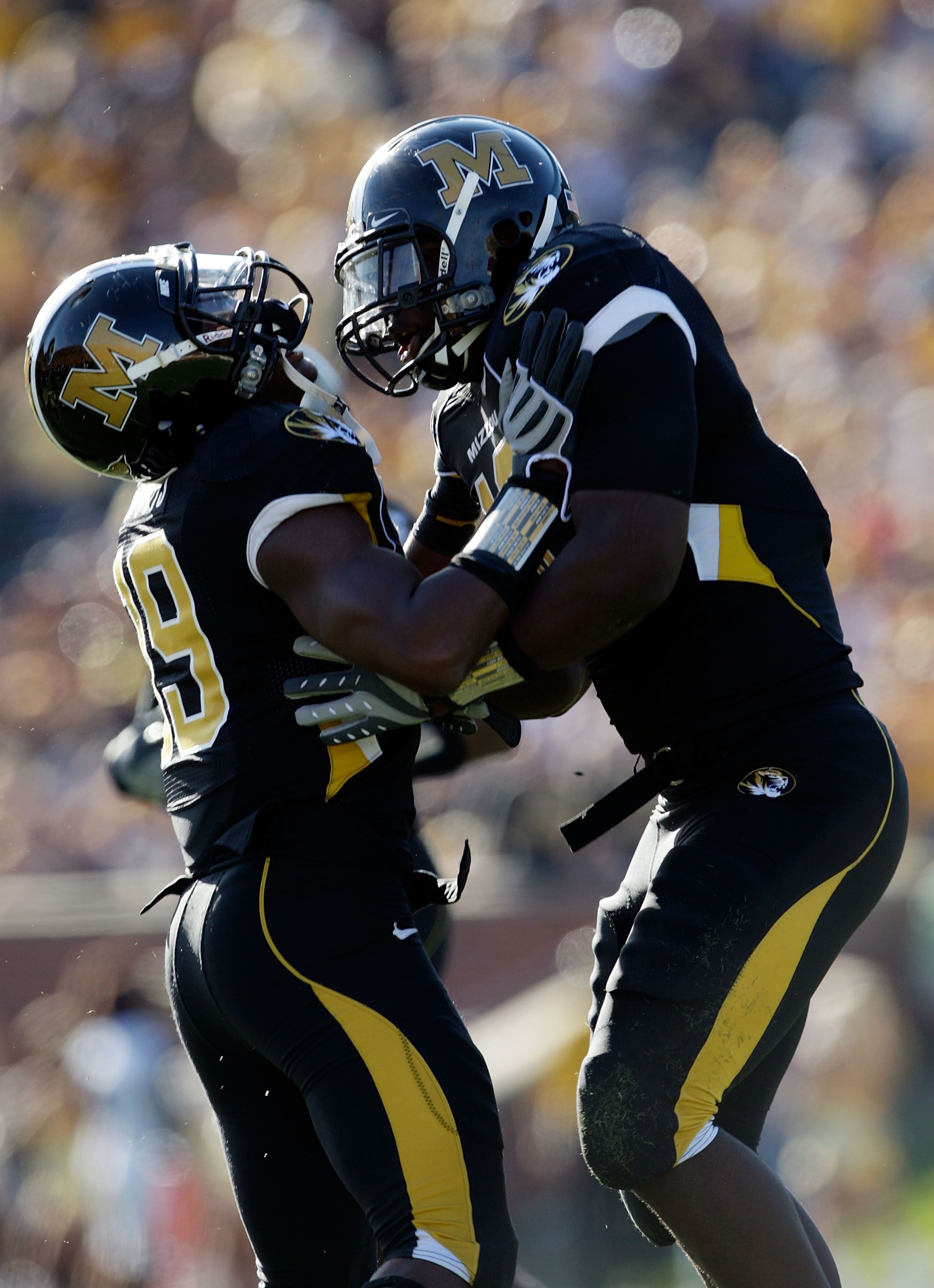 COLUMBIA, MO - NOVEMBER 07:  Linebacker Sean Weatherspoon #12 of the Missouri Tigers is congratulated by Carl Gettis #19 after the Tigers stopped the Baylor Bears offense during the game at Faurot Field/Memorial Stadium on November 7, 2009 in Columbia, Mi