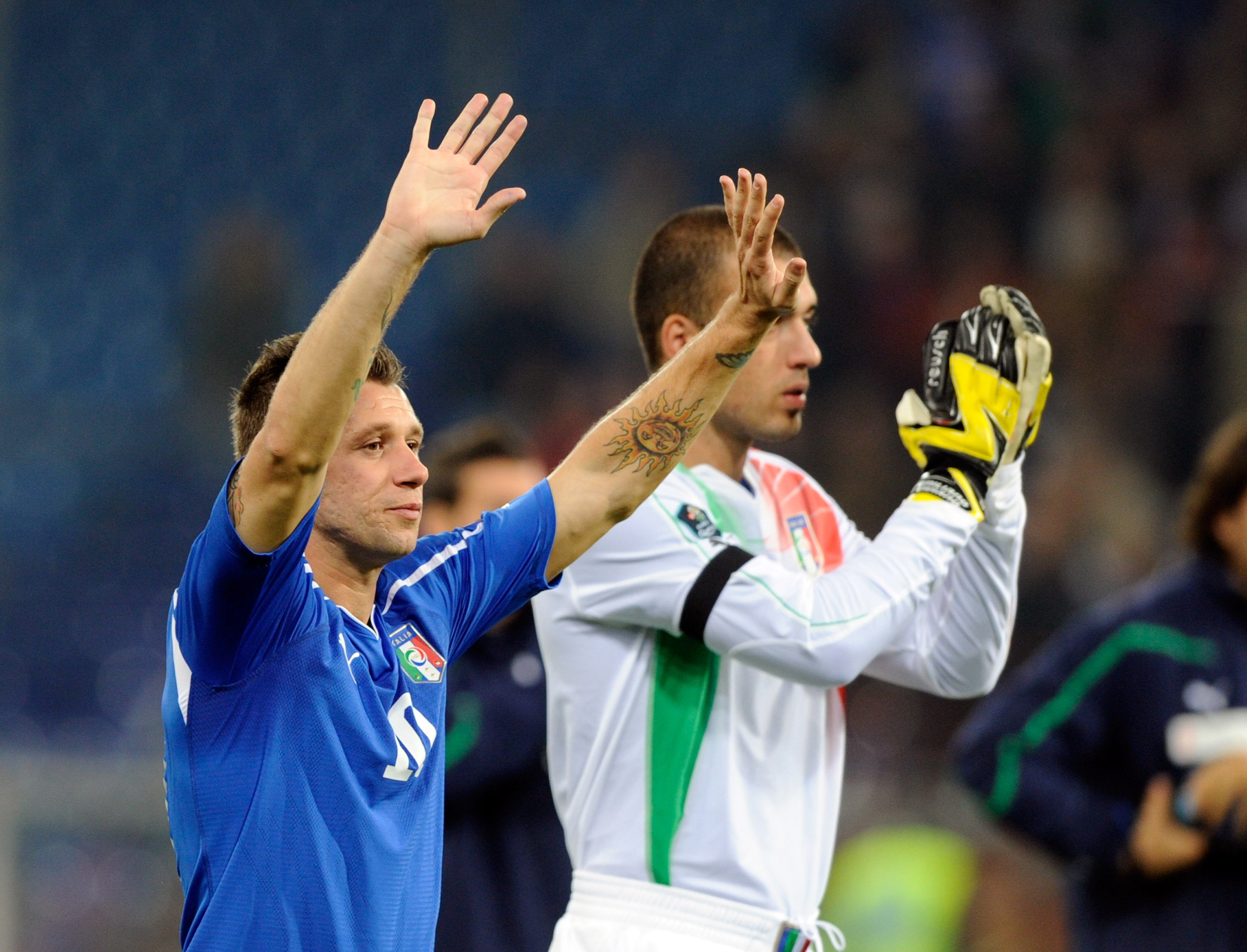 GENOA, ITALY - OCTOBER 12:  Antonio Cassano and Emiliano Viviano of Italy applaud the Italian fans during the UEFA EURO 2012 Group C qualifier  between Italy and Serbia at Luigi Ferraris Stadium on October 12, 2010 in Genoa, Italy.  (Photo by Claudio Vill