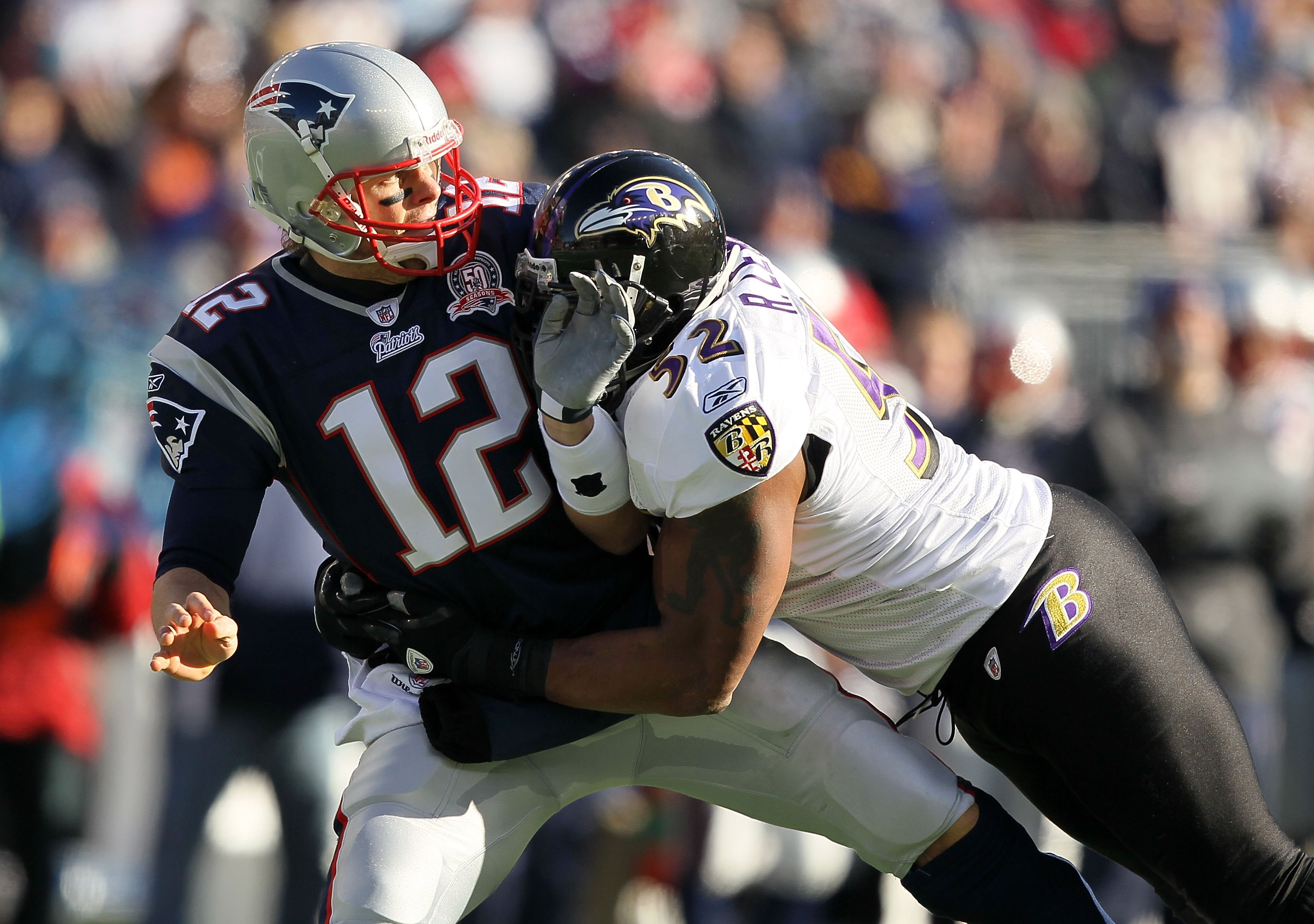 FOXBORO, MA - JANUARY 10:  Quarterback Tom Brady #12 of the New England Patriots is hit by Ray Lewis #52 of the Baltimore Ravens during the 2010 AFC wild-card playoff game at Gillette Stadium on January 10, 2010 in Foxboro, Massachusetts. The Ravens won 3
