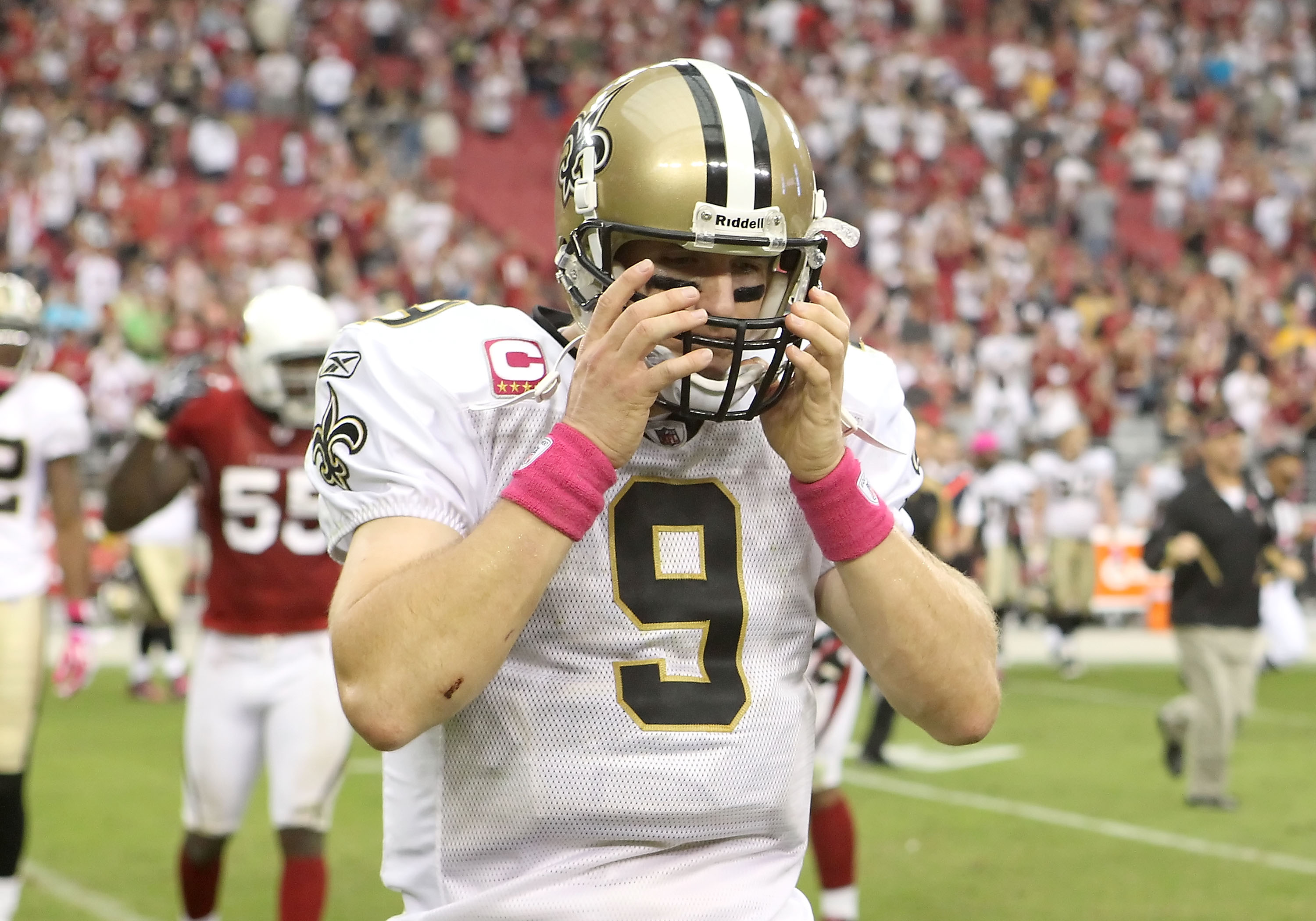 GLENDALE, AZ - OCTOBER 10:  Quarterback Drew Brees #9 of the New Orleans Saints reacts as he walks off the field after being defeated by the Arizona Cardinals in the NFL game at the University of Phoenix Stadium on October 10, 2010 in Glendale, Arizona. T