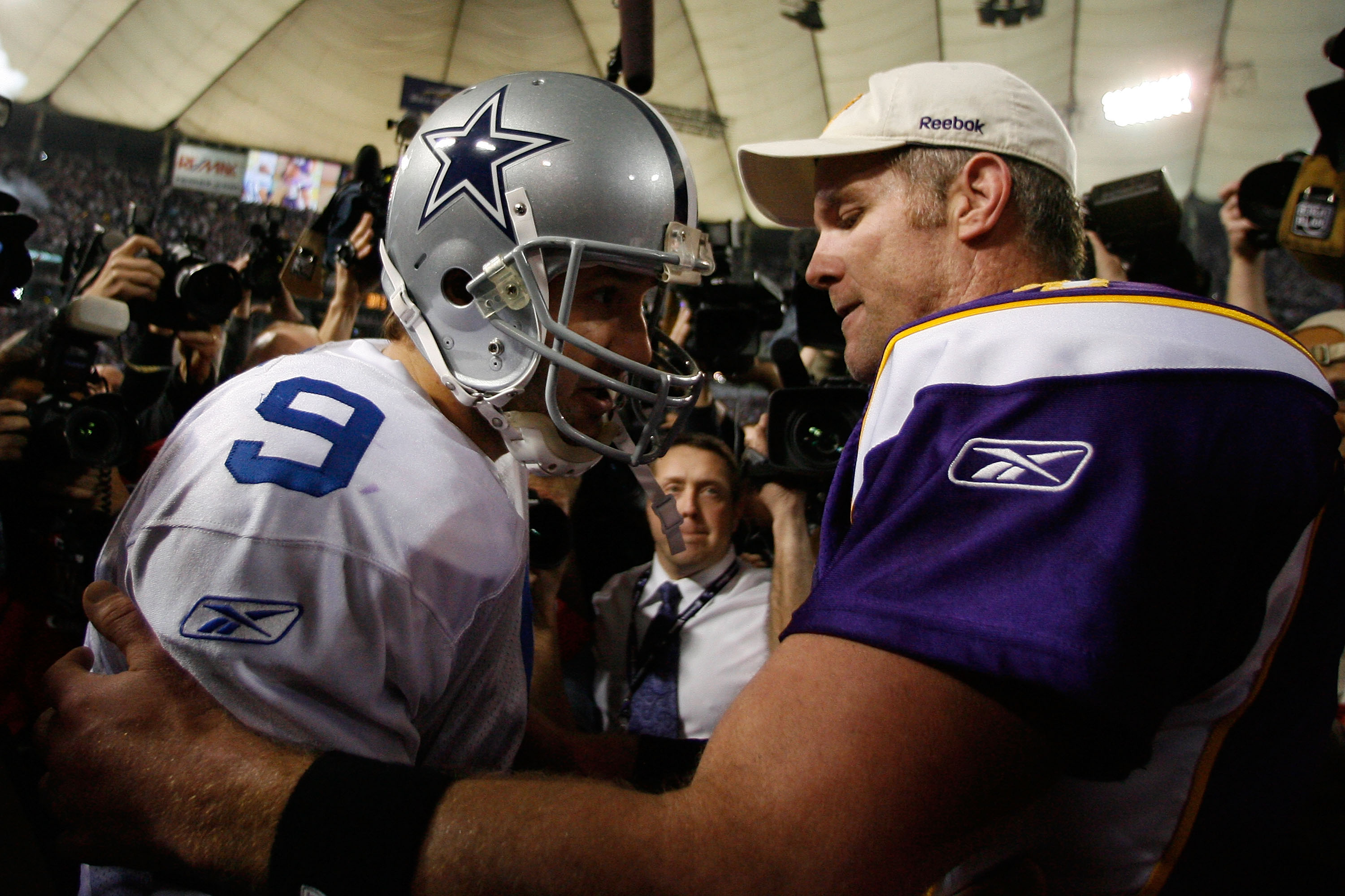 MINNEAPOLIS - JANUARY 17:  Quarterback Tony Romo #9 of the Dallas Cowboys congratulates quarterback Brett Favre #4 of the Minnesota Vikings on their 34-3 victory during the NFC Divisional Playoff Game at Hubert H. Humphrey Metrodome on January 17, 2010 in