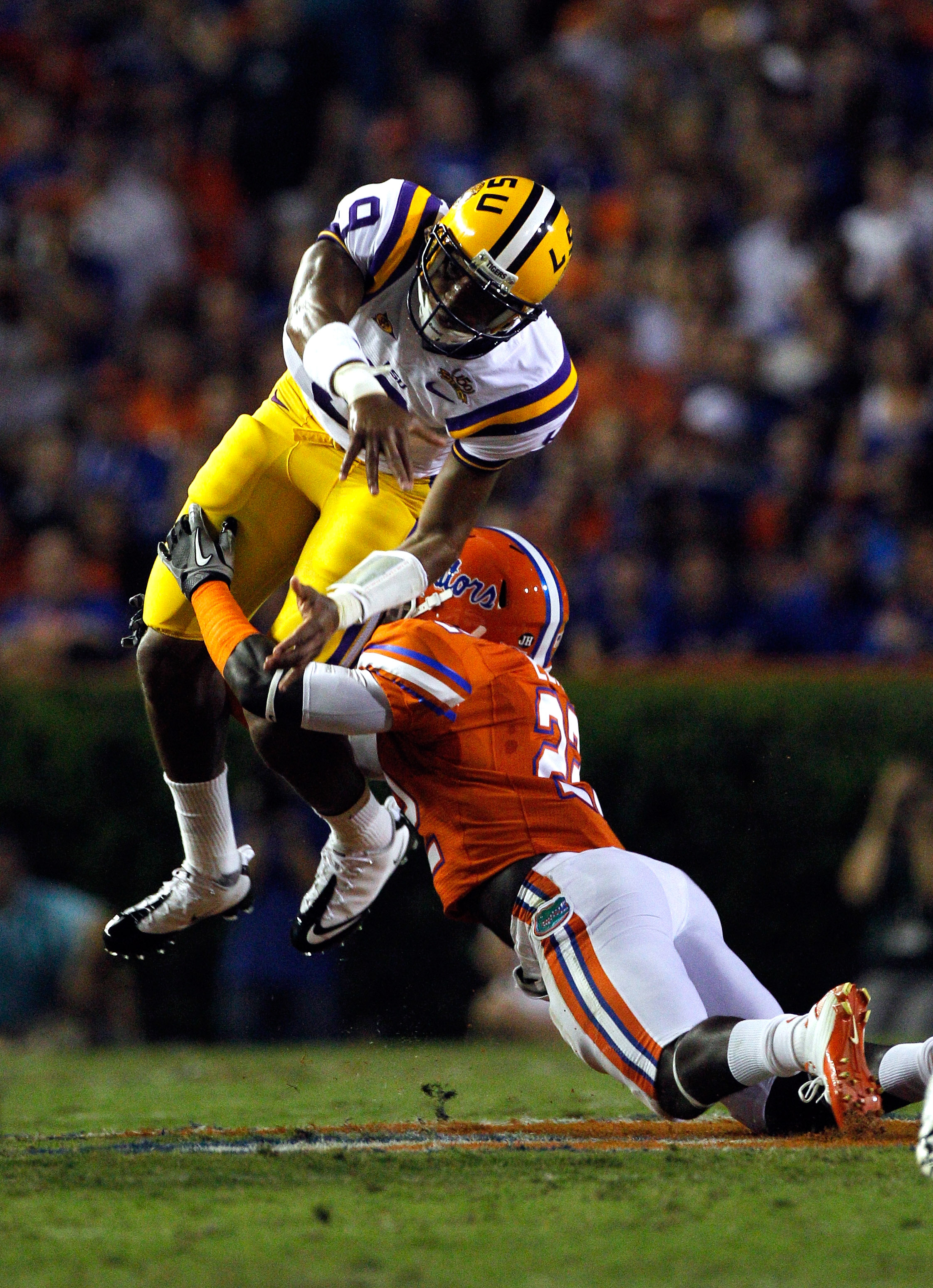GAINESVILLE, FL - OCTOBER 09:  Quarterback Jordan Jefferson #9 of the Louisiana State University Tigers is tackled by Matt Elam #22 of the Florida Gators during the game at Ben Hill Griffin Stadium on October 9, 2010 in Gainesville, Florida.  (Photo by Sa