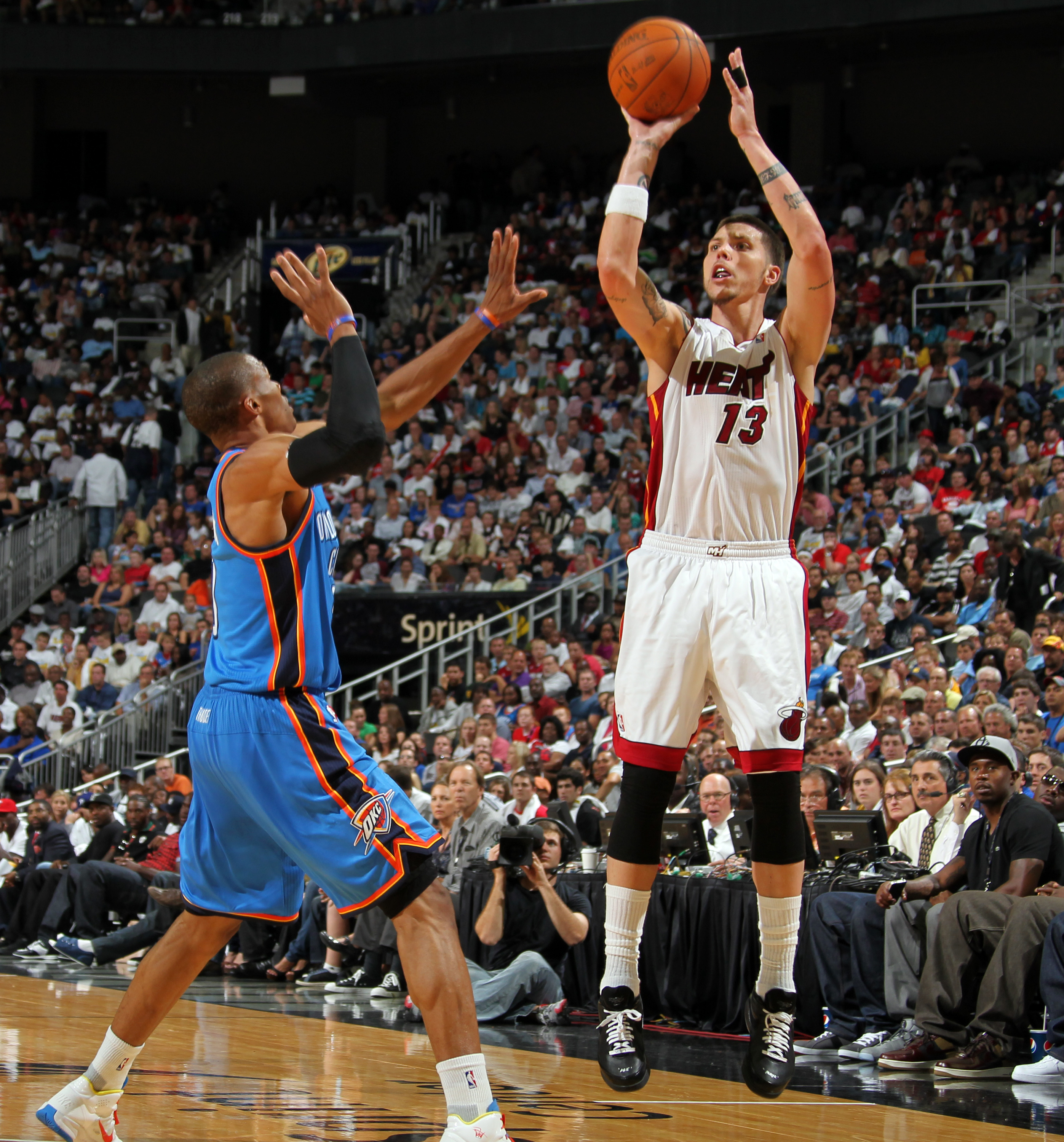 KANSAS CITY, MO - OCTOBER 8: Mike Miller #13 of the Miami Heat shoots a jumpshot over Thabo Sefolosha #2 of the Oklahoma City Thunder on October 8, 2010 at the Sprint Center in Kansas City, Missouri.  NOTE TO USER: User expressly acknowledges and agrees t