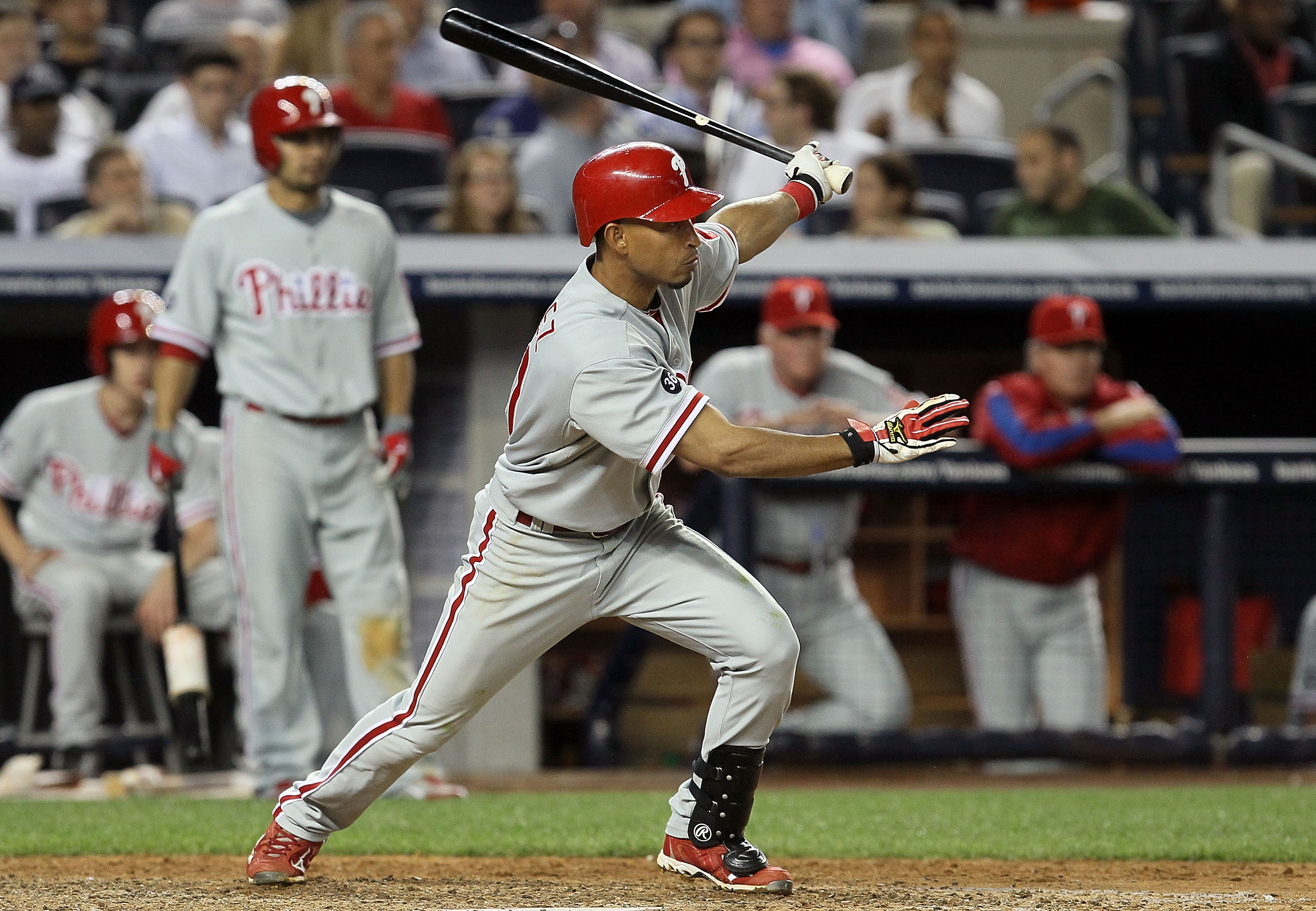 NEW YORK - JUNE 17:  Wilson Valdez #21 of the Philadelphia Phillies follows through on a RBI single in the ninth inning against the New York Yankees on June 17, 2010 at Yankee Stadium in the Bronx borough of New York City. The Phillies defeated the Yankee