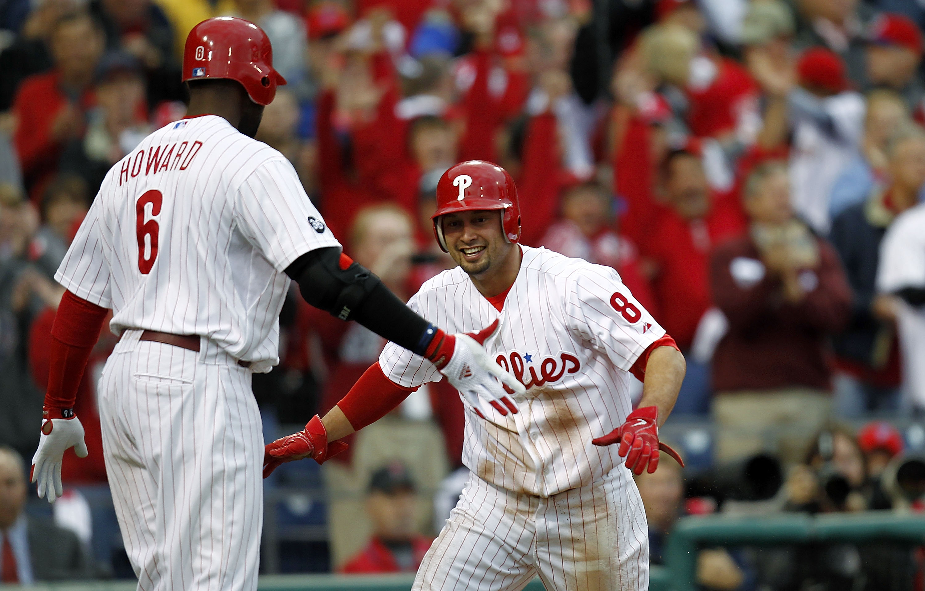 PHILADELPHIA - OCTOBER 06: Ryan Howard #6 and Shane Victorino #8 of the Philadelphia Phillies celebrate a run in Game 1 of the NLDS against the Cincinnati Reds at Citizens Bank Park on October 6, 2010 in Philadelphia, Pennsylvania.  (Photo by Jeff Zelevan