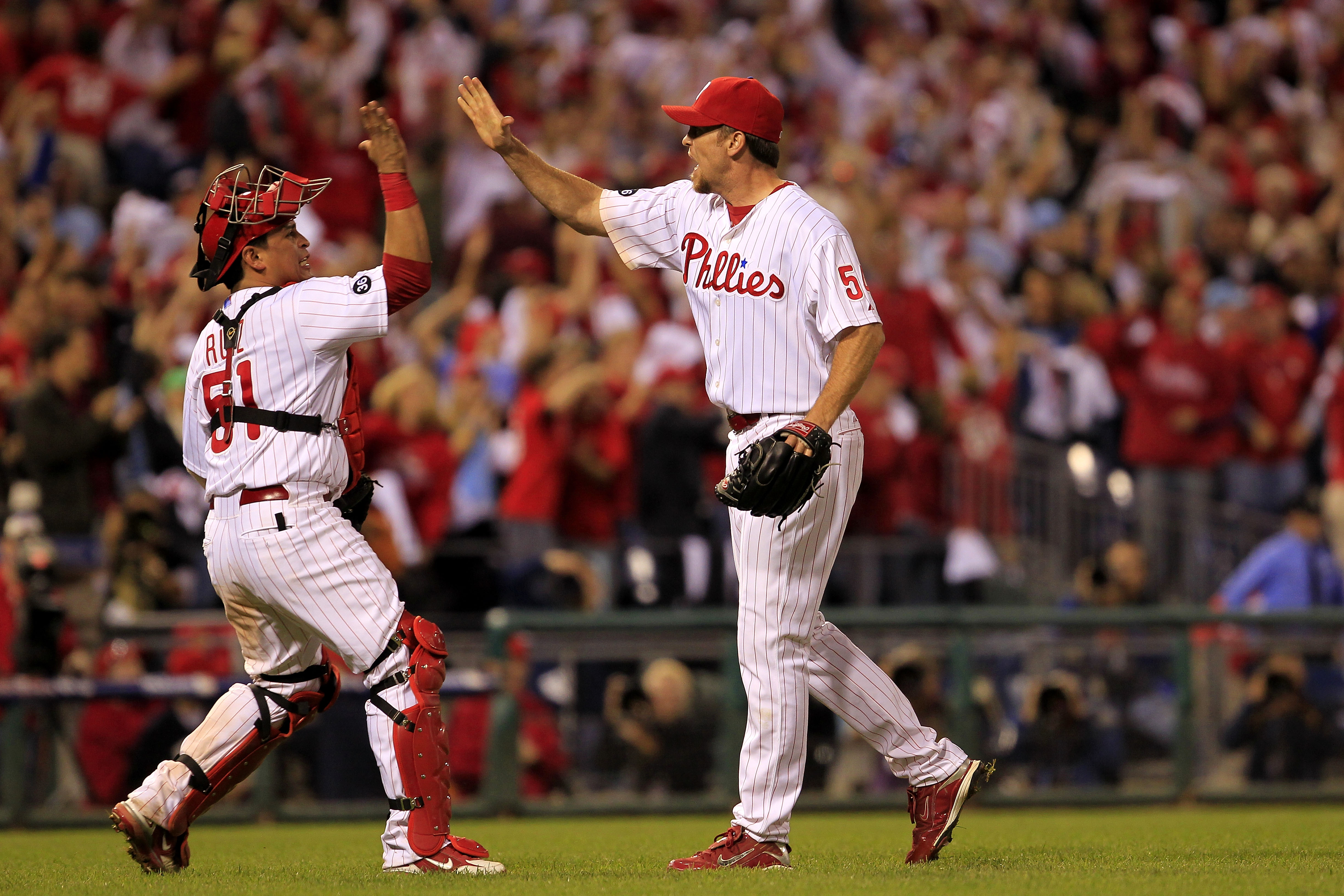 PHILADELPHIA - OCTOBER 08:  Carlos Ruiz #51 and Brad Lidge #54 of the Philadelphia Phillies celebrate a victory over the Cincinnati Reds in game 2 of NLDS at Citizens Bank Park on October 8, 2010 in Philadelphia, Pennsylvania. The Phillies defeated the Re