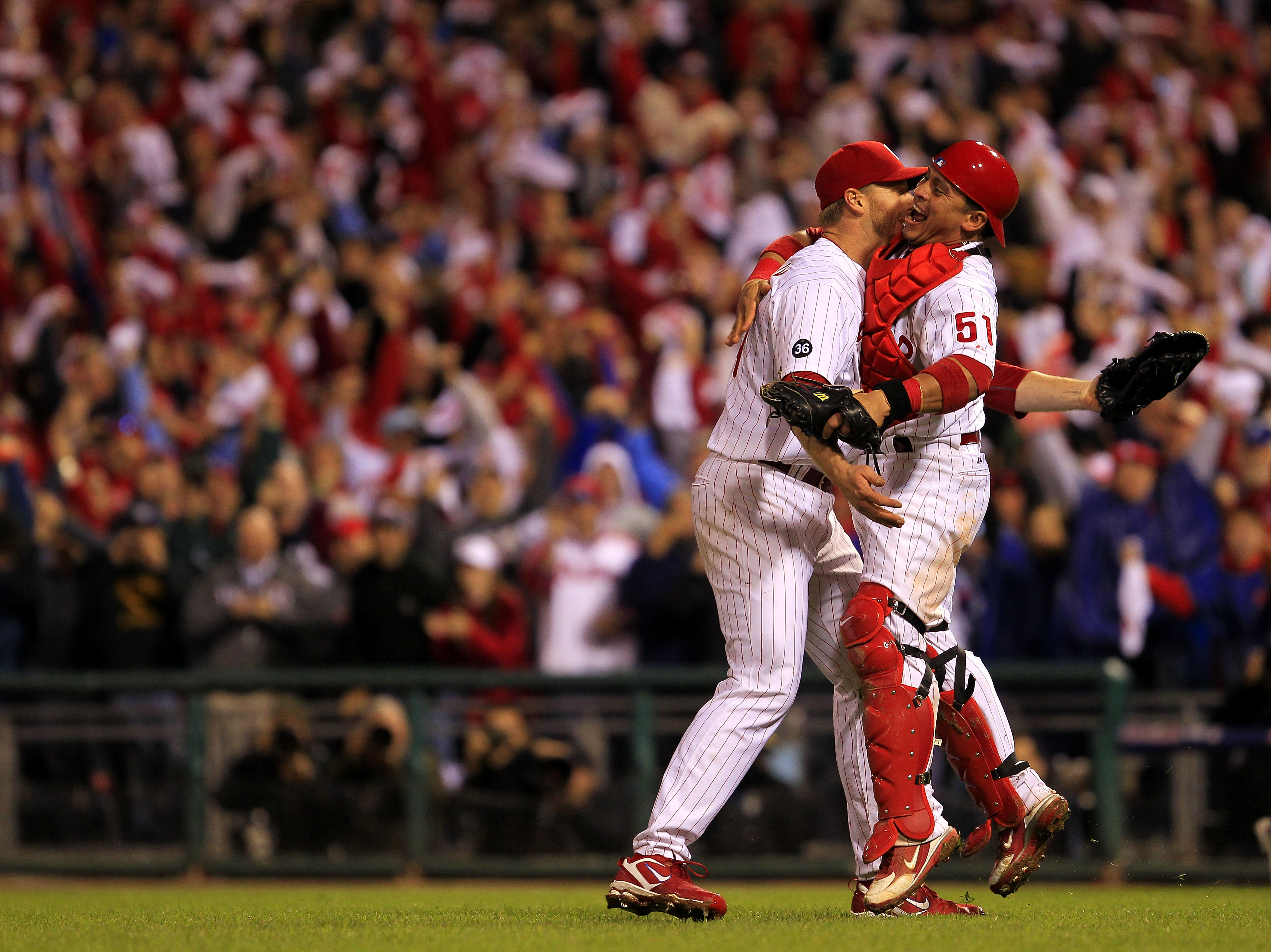 PHILADELPHIA - OCTOBER 06:  Roy Halladay #34 and Carlos Ruiz #51 of the Philadelphia Phillies celebrate Halladay's no-hitter and the win in Game 1 of the NLDS against the Cincinnati Reds at Citizens Bank Park on October 6, 2010 in Philadelphia, Pennsylvan