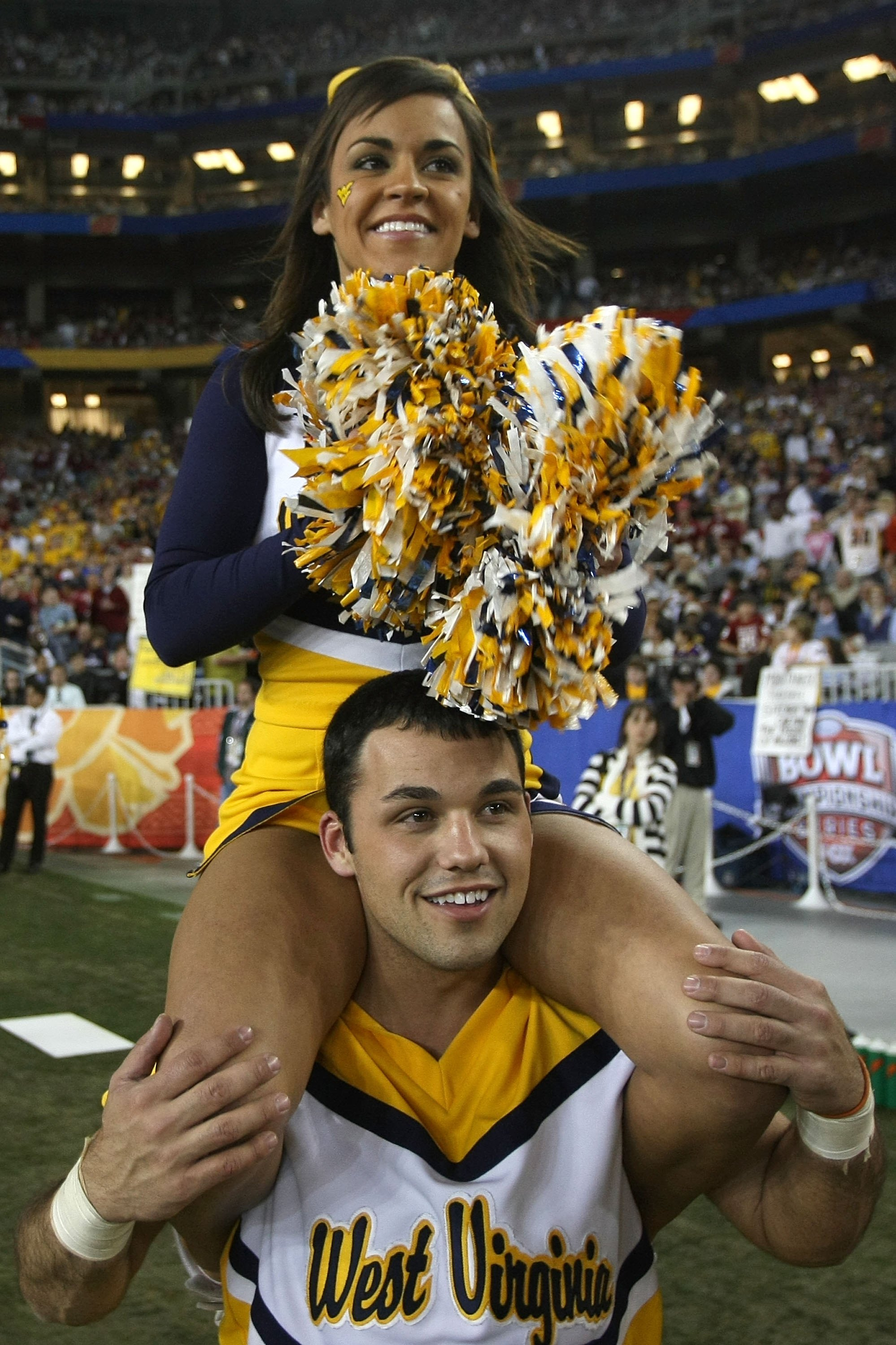GLENDALE, AZ - JANUARY 02:  Two West Virginia Mountaineers cheerleaders roam the sideline while the Mountaineers take on the Oklahoma Sooners at the Tostito's Fiesta Bowl at University of Phoenix Stadium January 2, 2008 in Glendale, Arizona.  (Photo by St