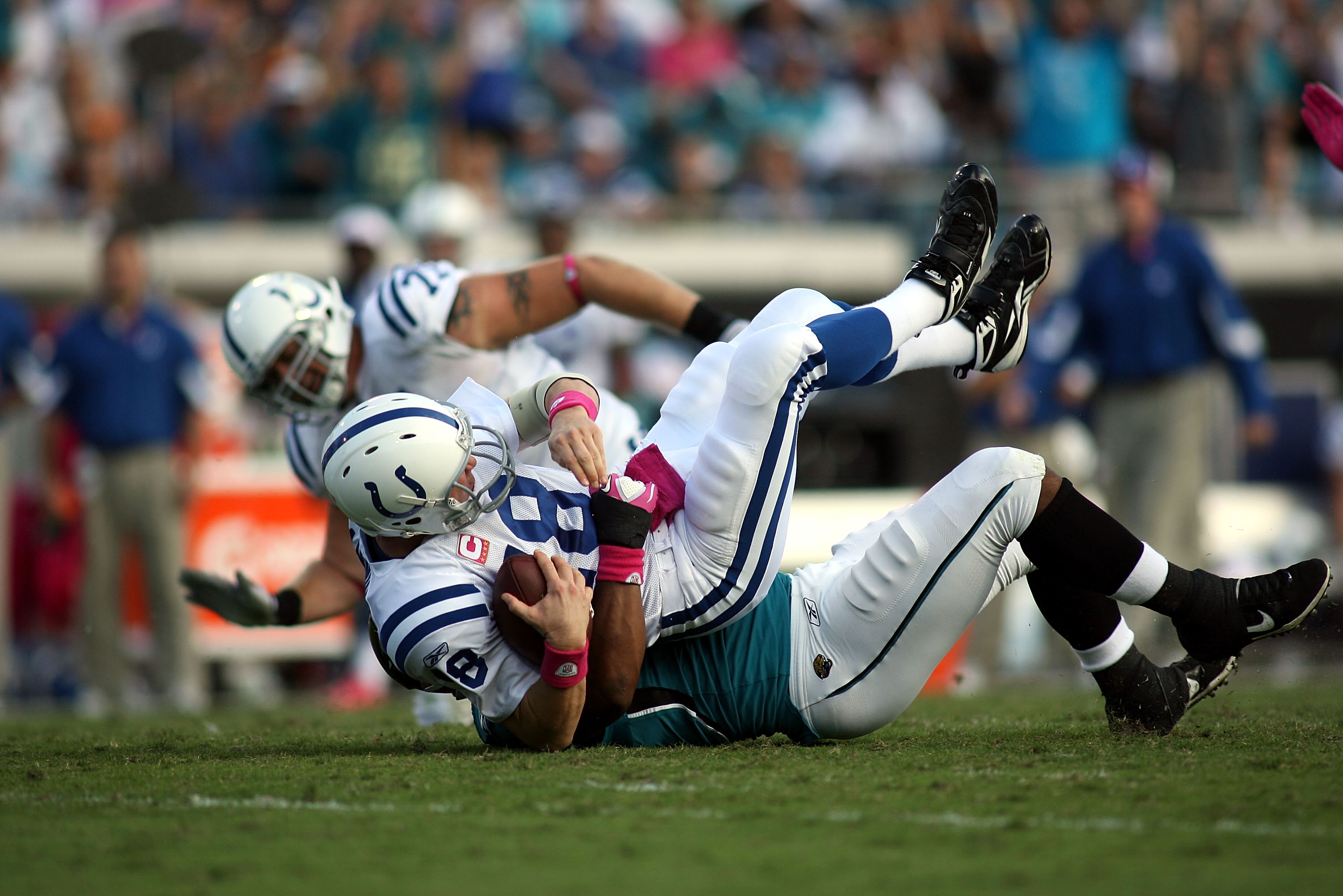 JACKSONVILLE, FL - OCTOBER 03:  Quarterback Peyton Manning #18 of the Indianapolis Colts is sacked by Lineman Jeremy Mincey #94 of the Jacksonville Jaguars at EverBank Field on October 3, 2010 in Jacksonville, Florida. The Jaguars won 31-28.  (Photo by Ma