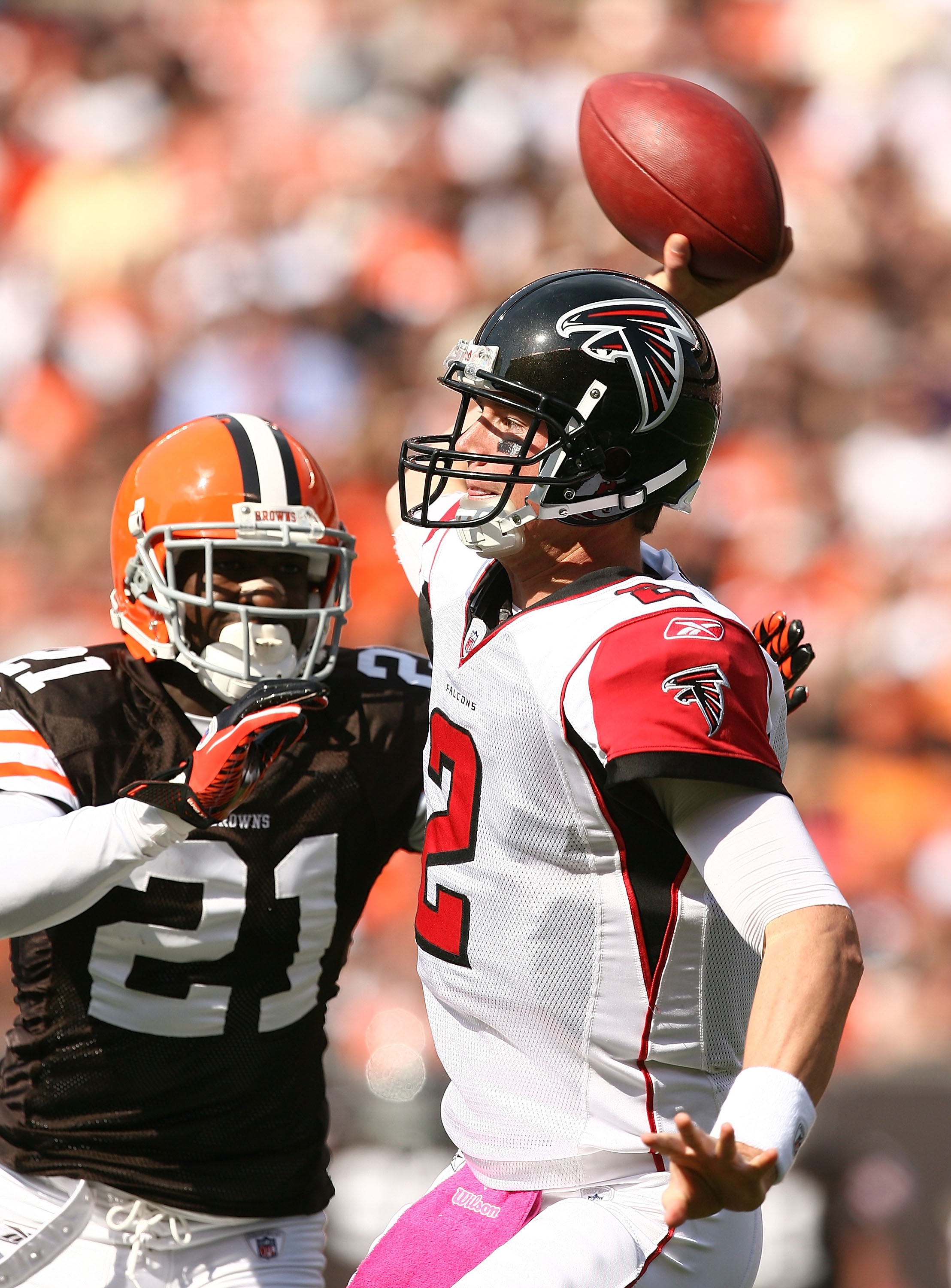CLEVELAND - OCTOBER 10:  Quarterback Matt Ryan #2 of the Atlanta Falcons throws to a receiver as he is pressured by defensive back Eric Wright #21 at Cleveland Browns Stadium on October 10, 2010 in Cleveland, Ohio.  (Photo by Matt Sullivan/Getty Images)