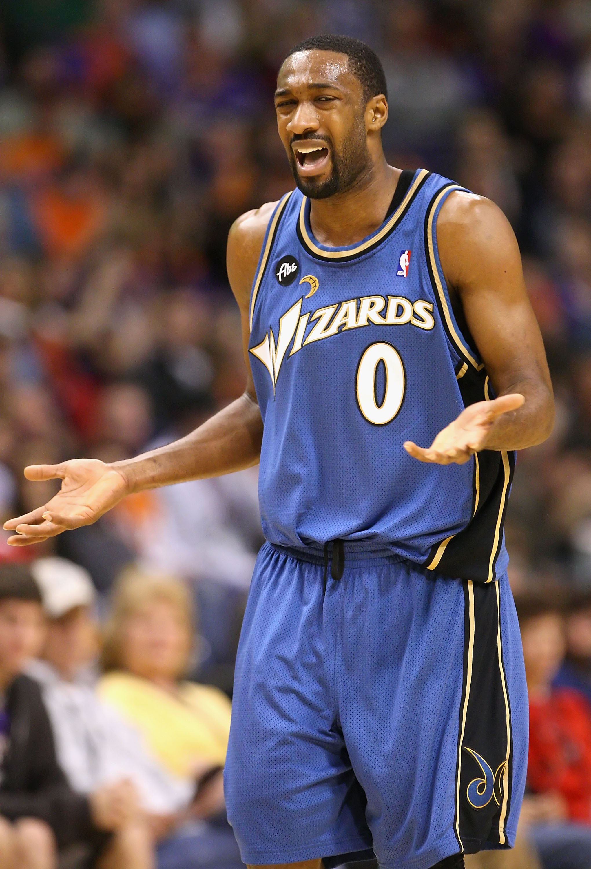PHOENIX - DECEMBER 19:  Gilbert Arenas #0 of the Washington Wizards reacts during the NBA game against the Phoenix Suns at US Airways Center on December 19, 2009 in Phoenix, Arizona. The Suns defeated the Wizards 121-95. NOTE TO USER: User expressly ackno