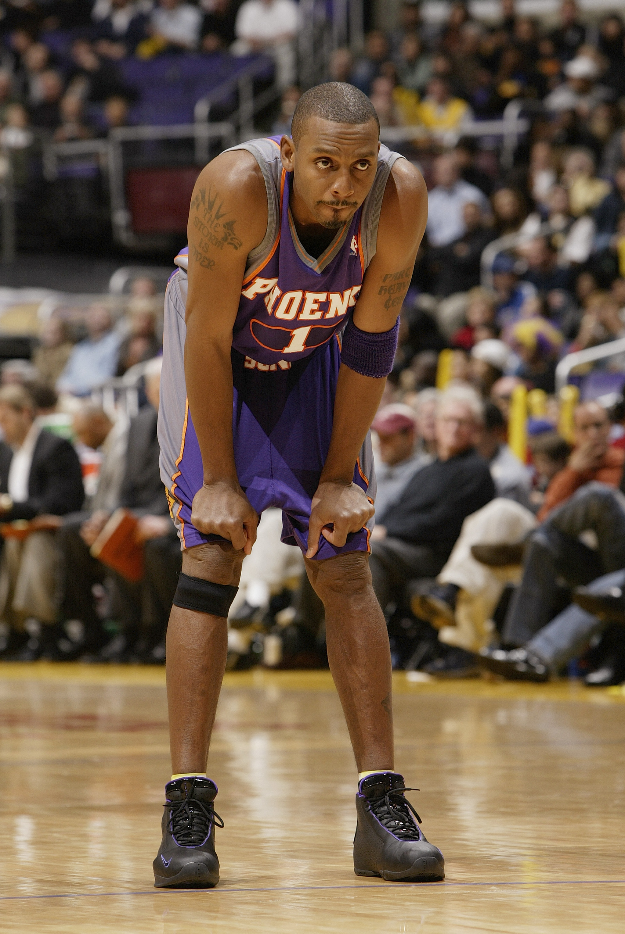 LOS ANGELES - DECEMBER 21:  Anfernee Hardaway #1 of the Phoenix Suns rests during the game against the Los Angeles Lakers at Staples Center on December 21, 2003 in Los Angeles, California.  The Lakers won 107-101.  (Photo by Stephen Dunn/Getty Images)