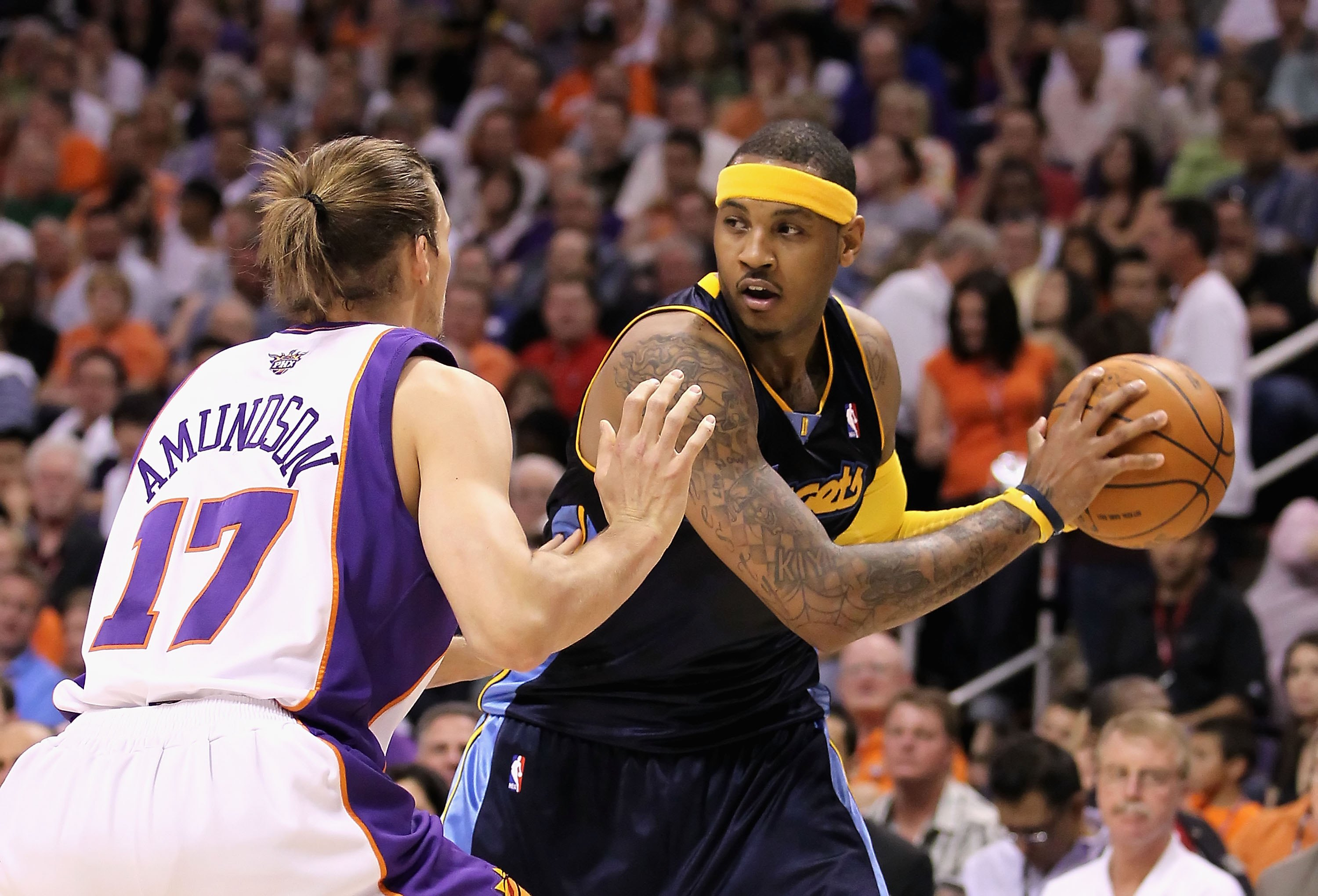 5437177d5717 PHOENIX - APRIL 13  Carmelo Anthony  15 of the Denver Nuggets handles the  ball