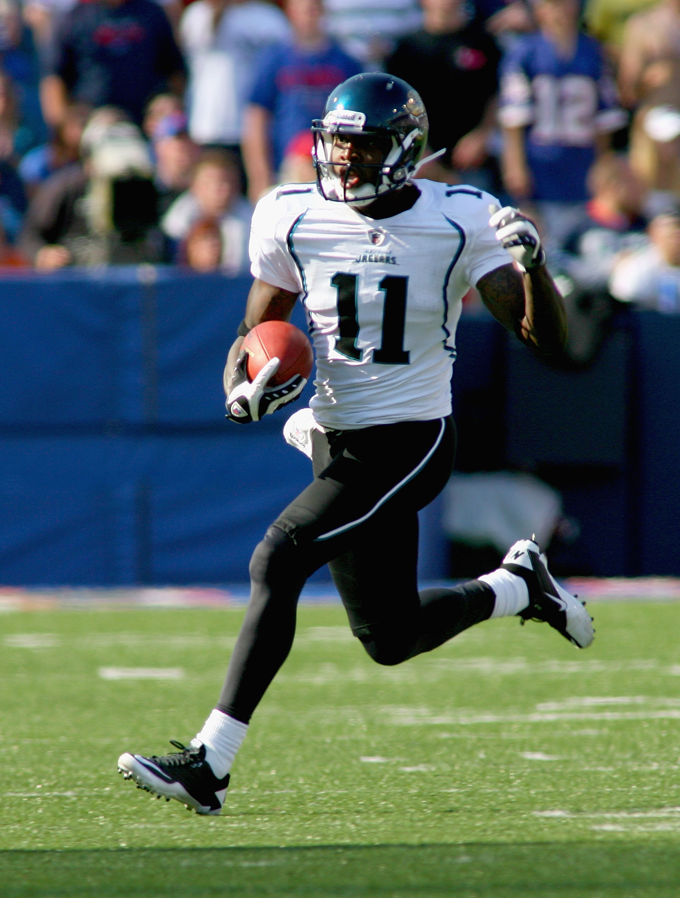 ORCHARD PARK, NY - OCTOBER 10: Mike Sims-Walker #11 of the Jacksonville Jaguars runs after a catch against the Buffalo Bills at Ralph Wilson Stadium on October 10, 2010 in Orchard Park, New York. Jacksonville won 36-26. (Photo by Rick Stewart/Getty Images
