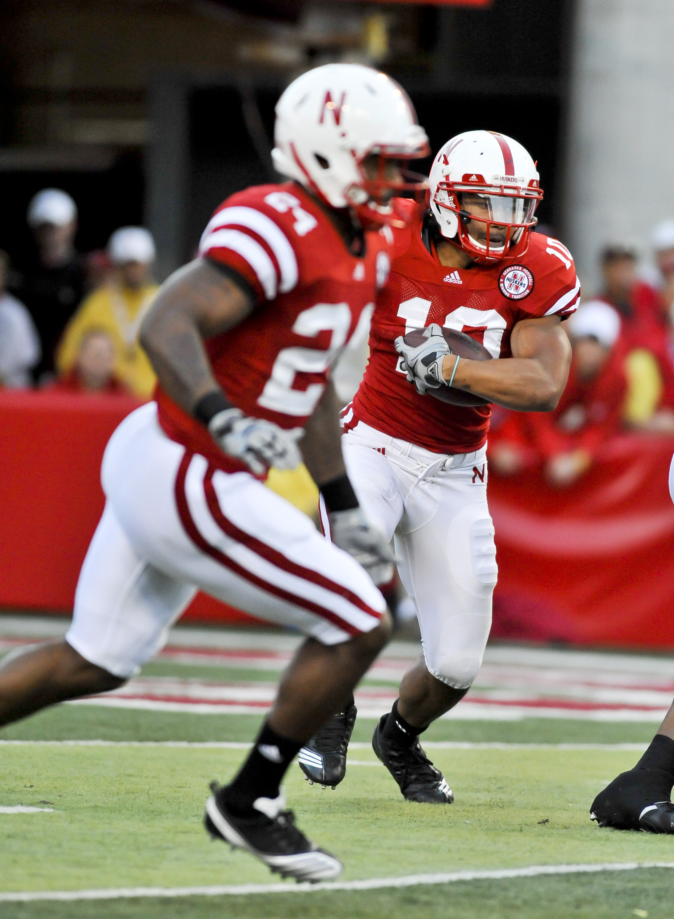 LINCOLN, NEBRASKA - SEPTEMBER 25: Nebraska Cornhuskers running back Roy Helu Jr. #10 follows wide receiver Niles Paul #24 during first half action of their game against the South Dakota State Jackrabbits at Memorial Stadium on September 25, 2010 in Lincol