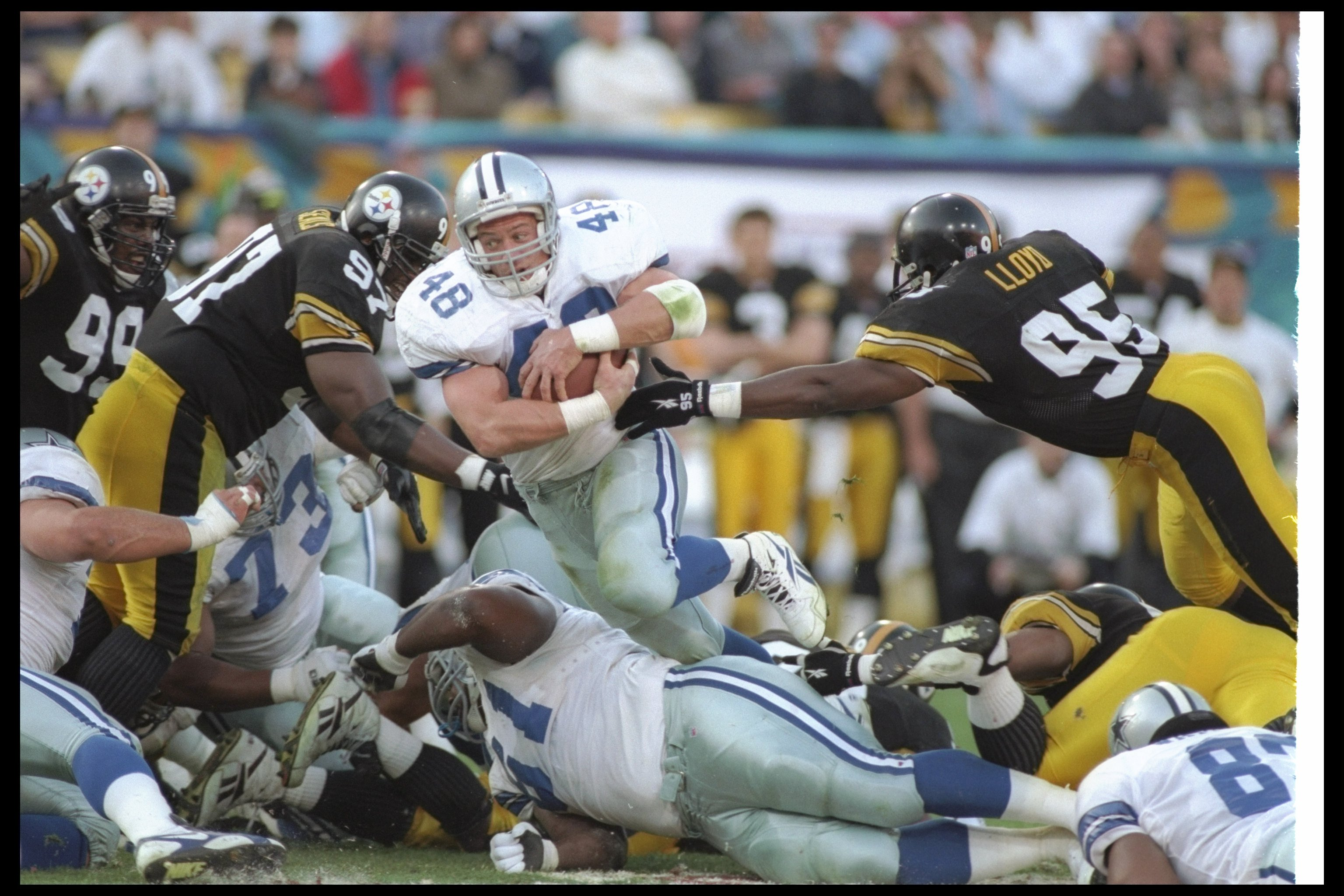 28 Jan 1996:  Running back Darryl Johnston of the Dallas Cowboys (center) breaks through the Pittsburgh Steelers line during Super Bowl XXX at Sun Devil Stadium in Tempe, Arizona.  The Cowboys won the game, 27-17. Mandatory Credit: Rick Stewart  /Allsport