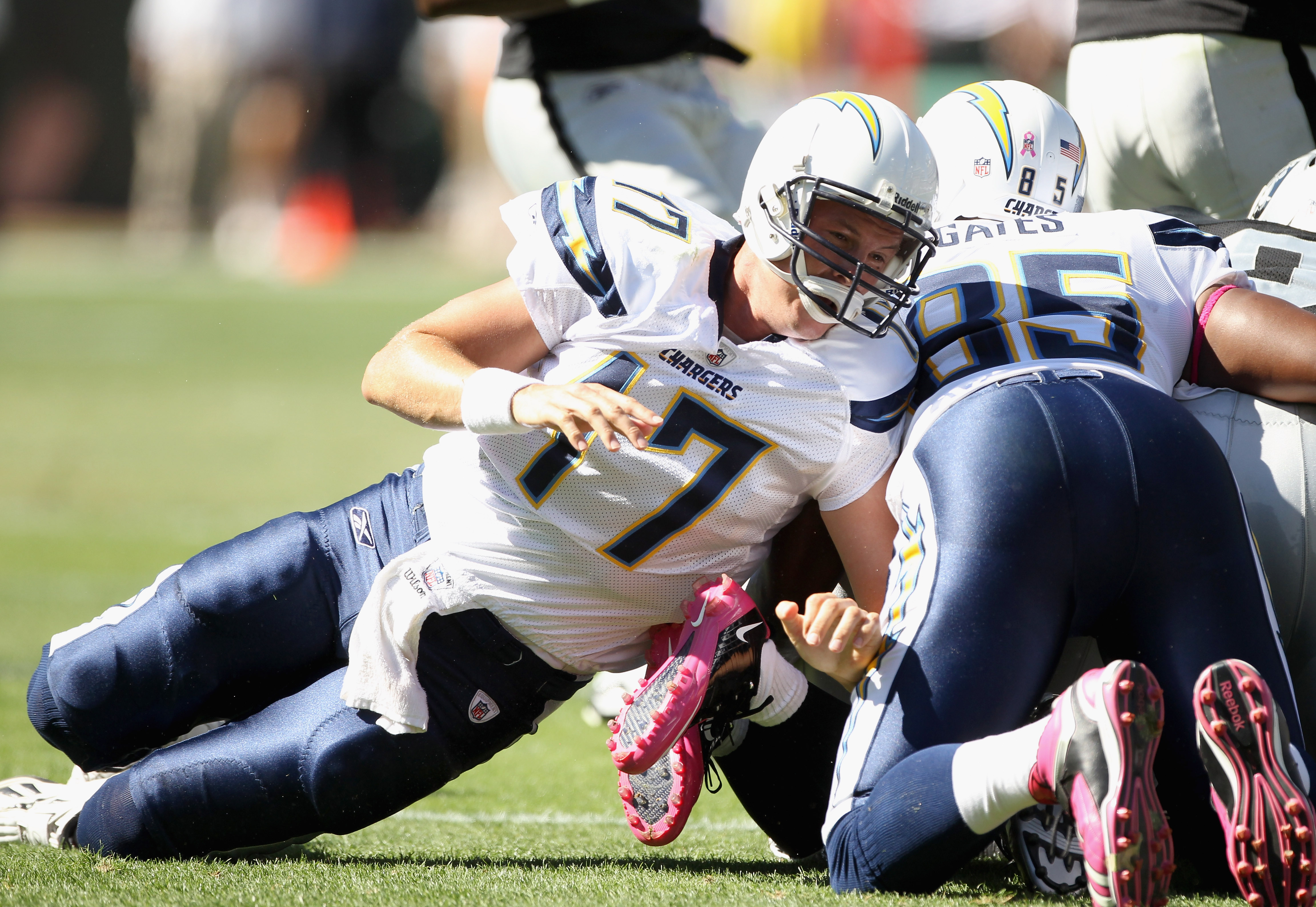 OAKLAND, CA - OCTOBER 10:  Philip Rivers #17 of the San Diego Chargers tries to help with a tackle after the Chargers fumbled the ball against the Oakland Raiders at Oakland-Alameda County Coliseum on October 10, 2010 in Oakland, California.  (Photo by Ez