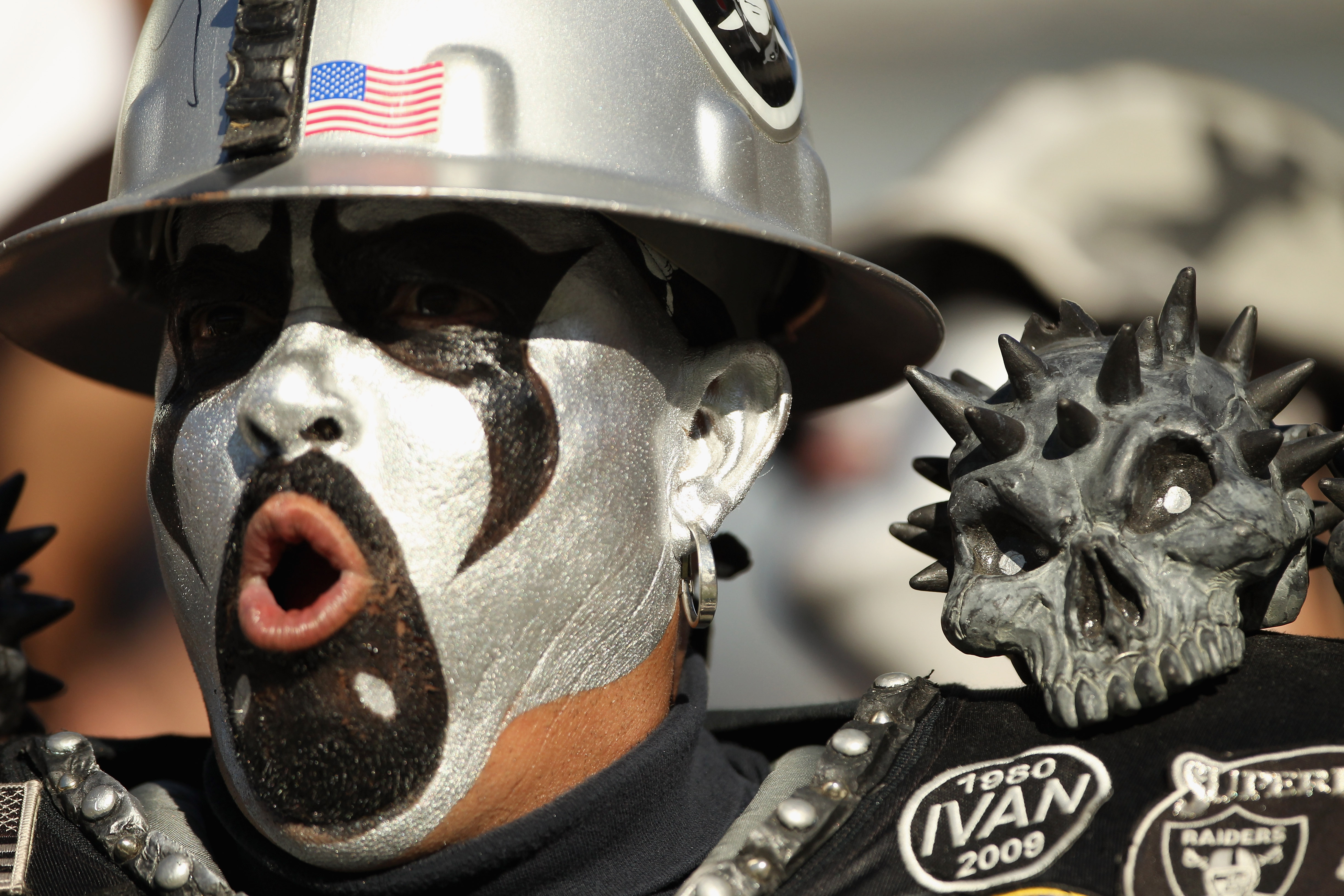 OAKLAND, CA - OCTOBER 10:  An Oakland Raiders fan cheers on his team during their game against the San Diego Chargers at Oakland-Alameda County Coliseum on October 10, 2010 in Oakland, California.  (Photo by Ezra Shaw/Getty Images)