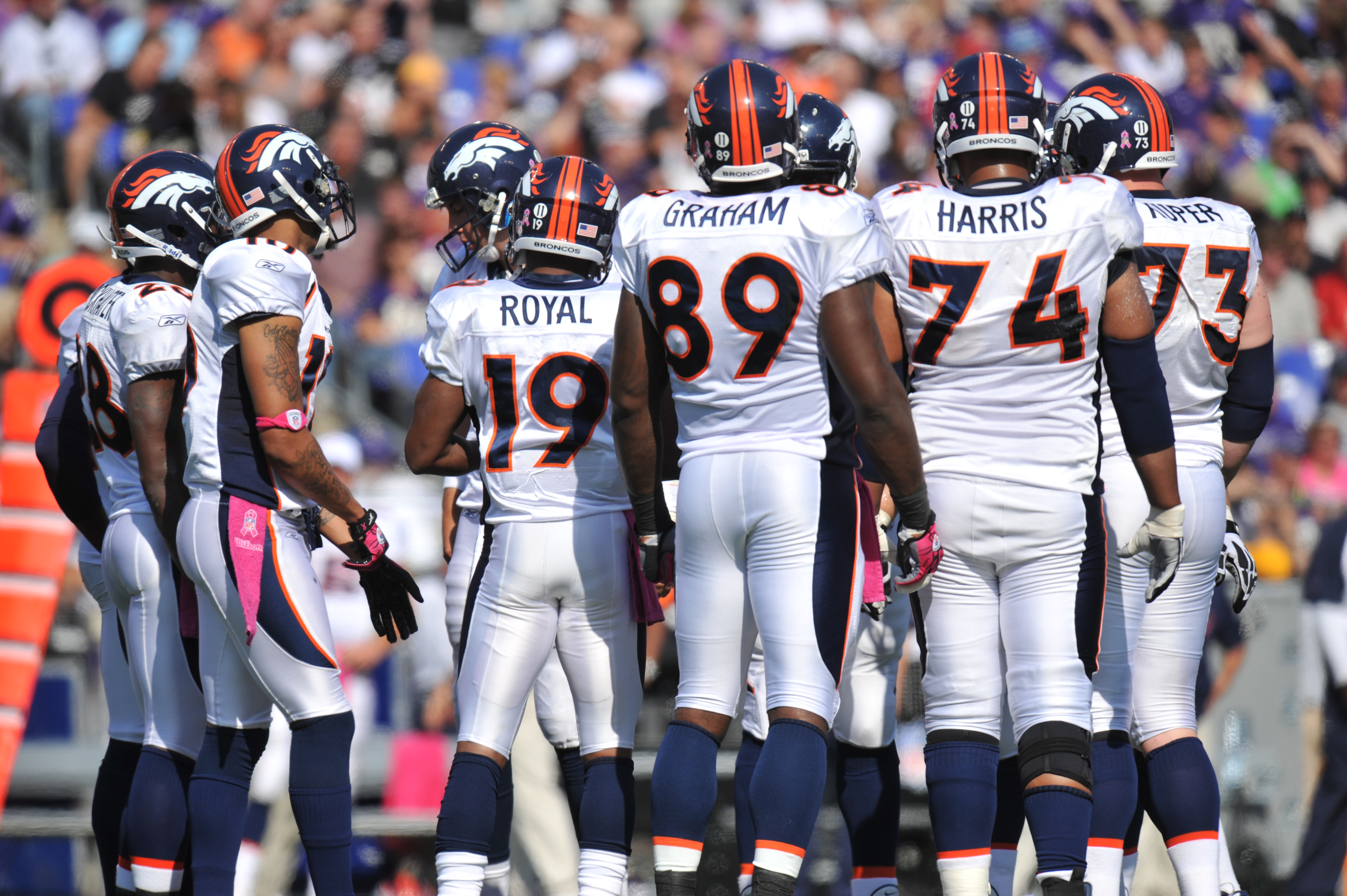 BALTIMORE, MD - OCTOBER 10: The Denver Broncos offense huddles during the game against the Baltimore Ravens at M&T Bank Stadium on October 10, 2010 in Baltimore, Maryland. Players wore pink in recognition of Breast Cancer Awareness Month. The Ravens defea
