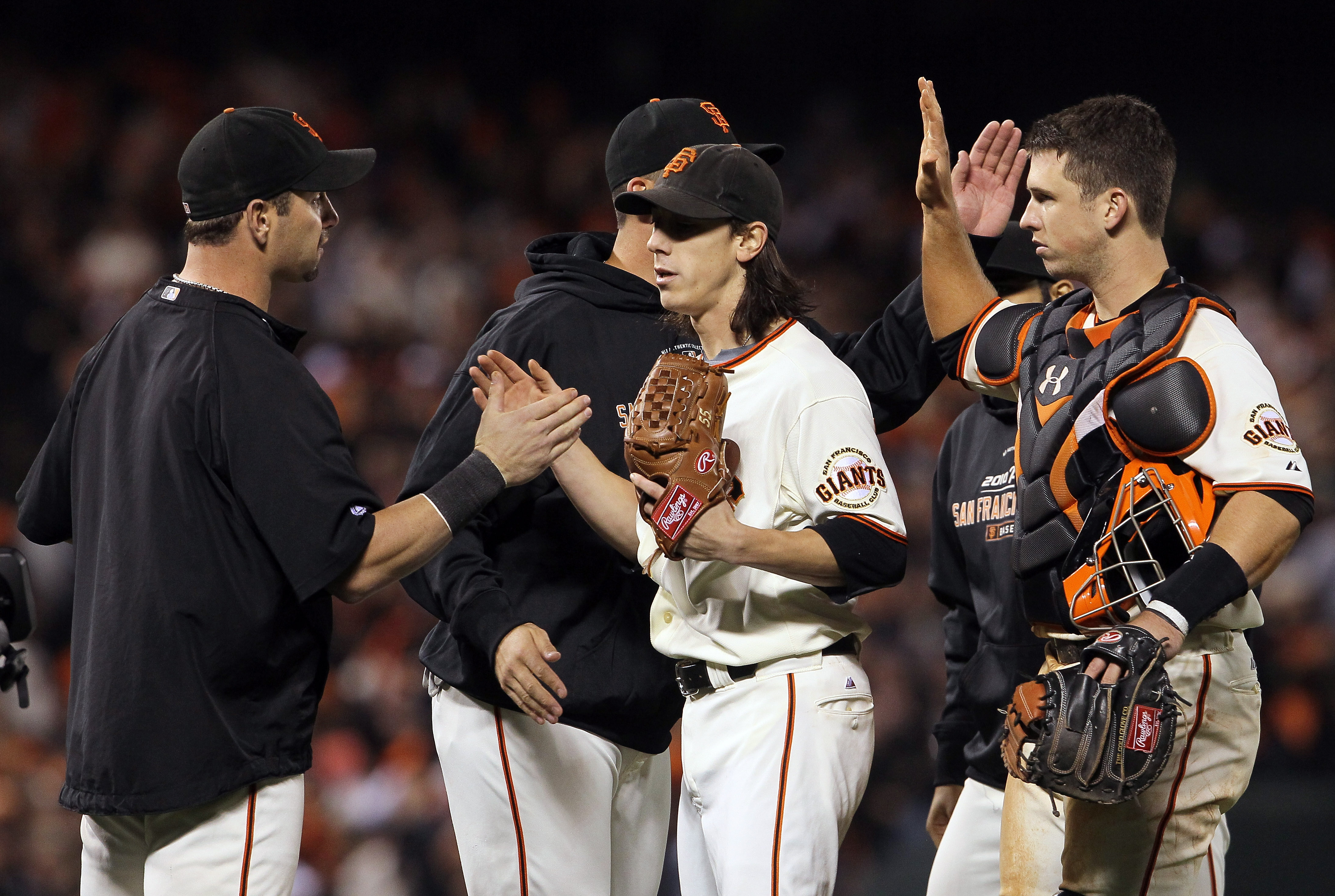 SAN FRANCISCO - OCTOBER 07:  Tim Lincecum #55 of the San Francisco Giants and teammate Buster Posey #28 are congratulated after pitching a complete game against the Atlanta Braves during game one of the National League Division Series at AT&T Park on Octo