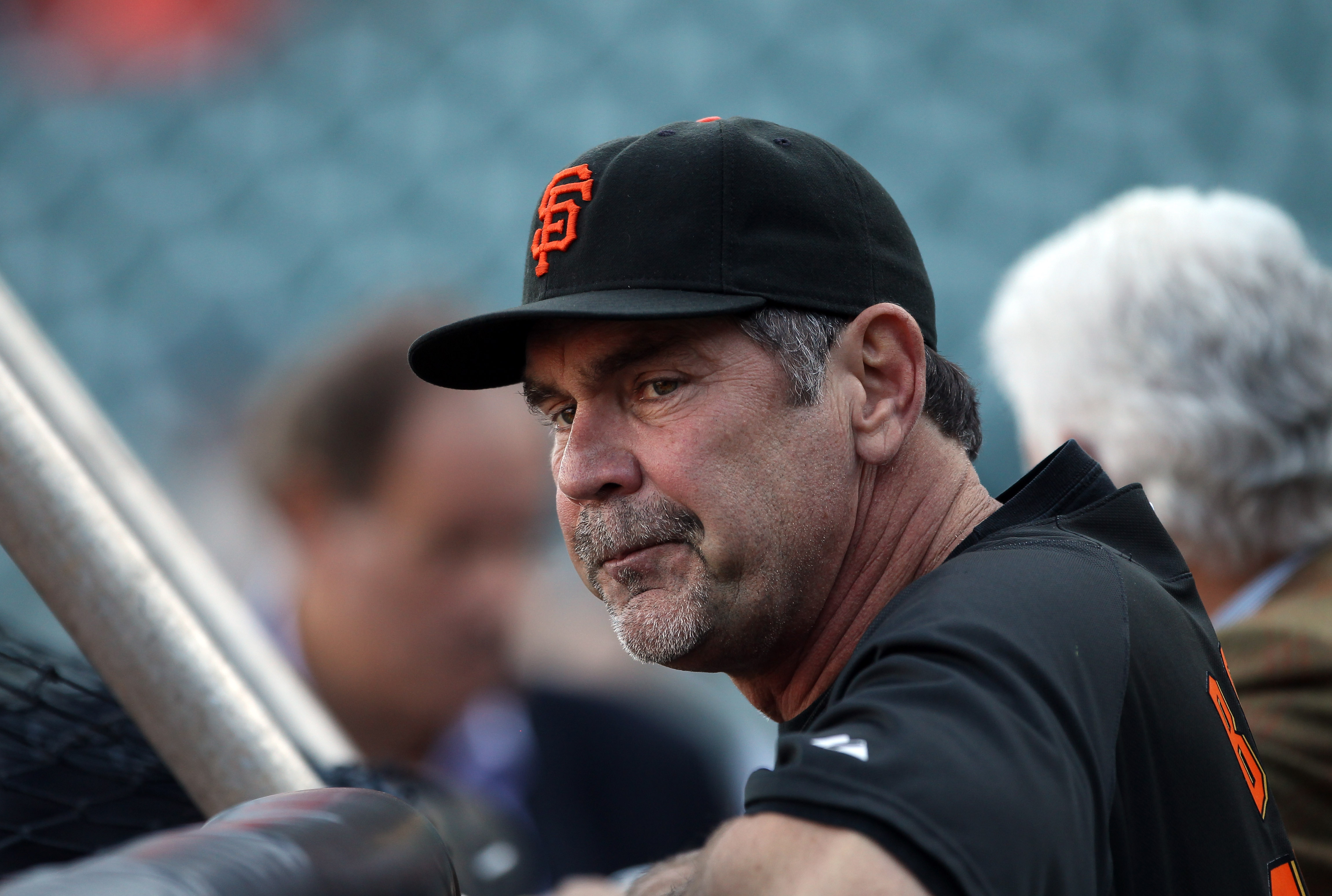 SAN FRANCISCO - OCTOBER 08:  Manager Bruce Bochy of the San Francisco Giants watches his team warm up before their game against the Atlanta Braves in game 2 of the NLDS at AT&T Park on October 8, 2010 in San Francisco, California.  (Photo by Ezra Shaw/Get
