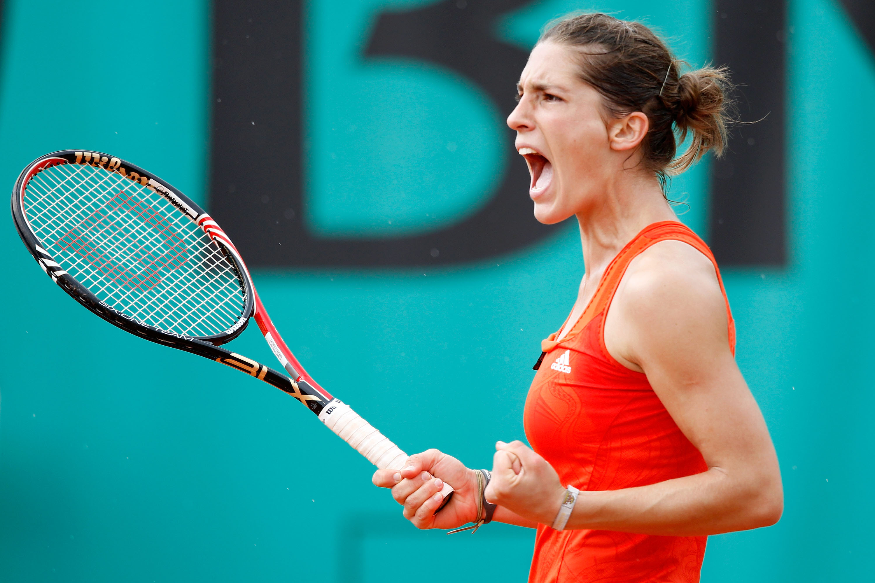 PARIS - MAY 26:  Andrea Petkovic of Germany celebrates during the women's singles second round match between Svetlana Kuznetsova of Russia and Andrea Petkovic of Germany on day four of the French Open at Roland Garros on May 26, 2010 in Paris, France.  (P