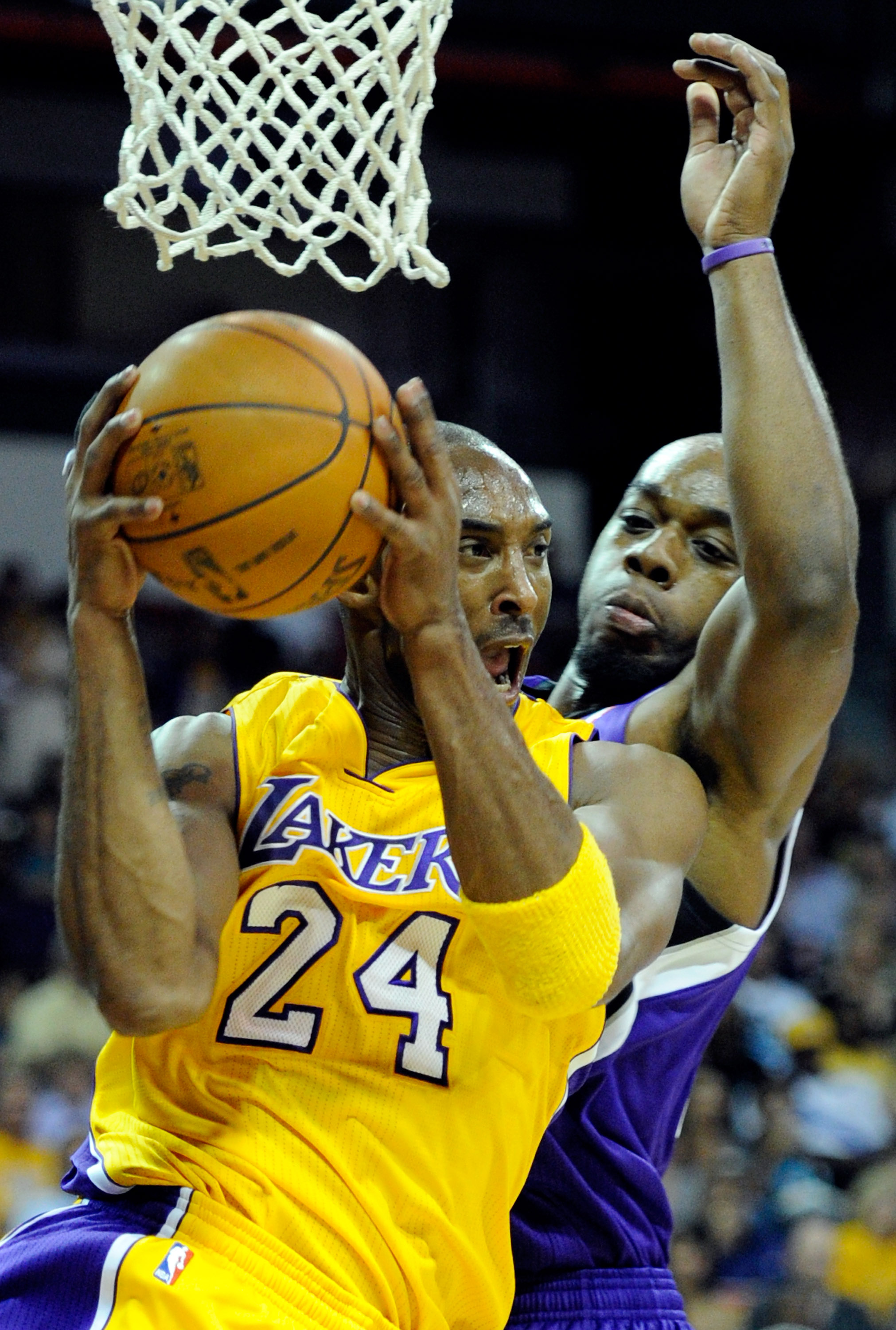 LAS VEGAS - OCTOBER 13:  Kobe Bryant #24 of the Los Angeles Lakers drives against Carl Landry #24 of the Sacramento Kings during their preseason game at the Thomas & Mack Center October 13, 2010 in Las Vegas, Nevada. The Lakers won 98-95. NOTE TO USER: Us