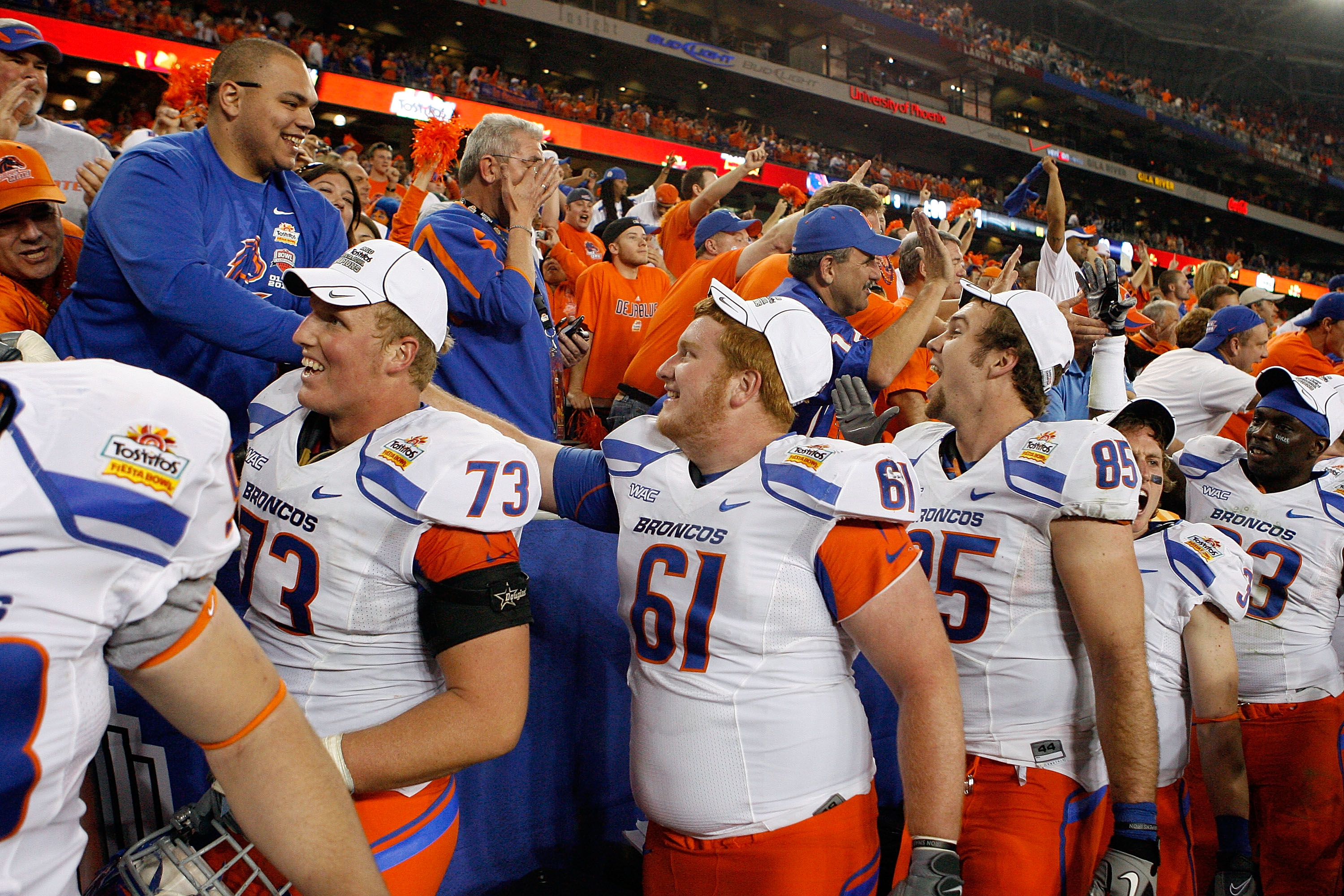 GLENDALE, AZ - JANUARY 04:  Nate Potter #73, Joe Kellogg #61 and Tommy Gallarda #85 of the Boise State Broncos and other teammates shake hands with their fans after their 17-10 victory against the TCU Horned Frogs during the Tostitos Fiesta Bowl at the Un